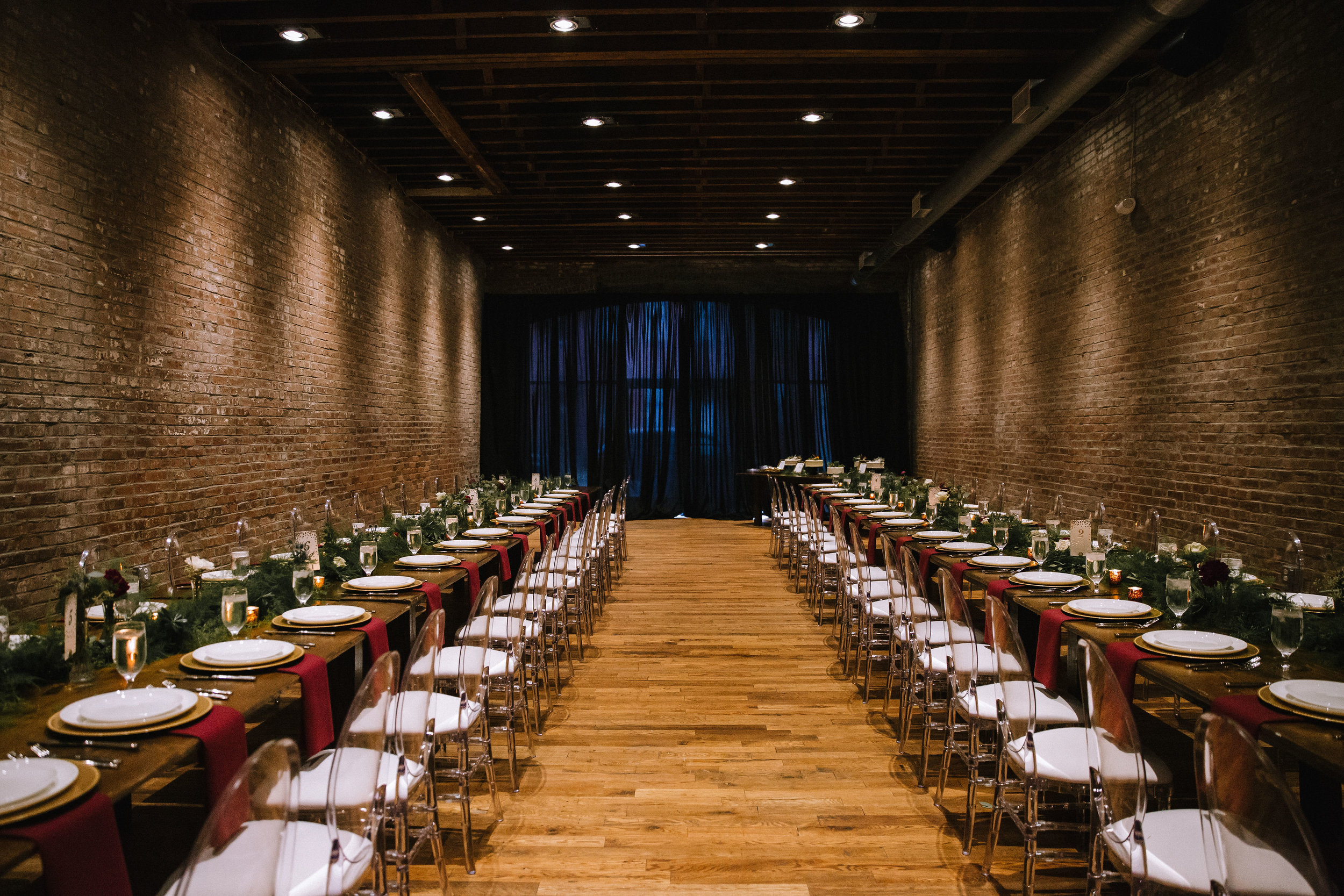 Wedding reception design with family style tables with greenery for Pittsburgh wedding at Studio Slate planned by Exhale Events. Find more wedding inspiration at exhale-events.com!