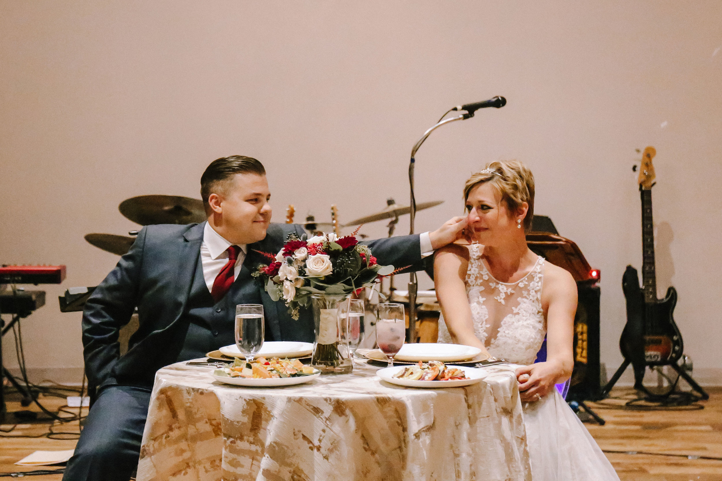 Bride and groom at wedding sweetheart table for Pittsburgh wedding at Studio Slate planned by Exhale Events. Find more wedding inspiration at exhale-events.com!
