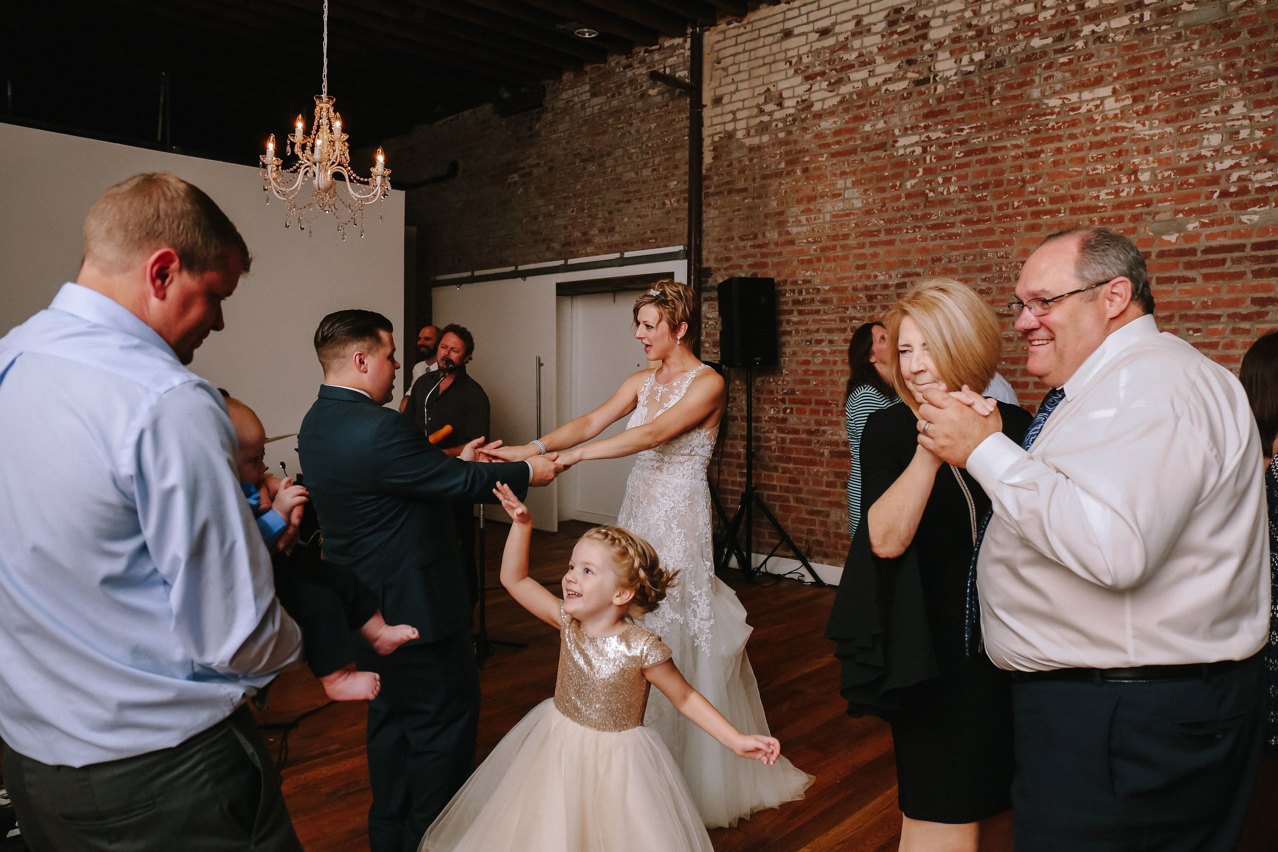 Bride and groom celebrating at wedding reception for Pittsburgh wedding at Studio Slate planned by Exhale Events. Find more wedding inspiration at exhale-events.com!