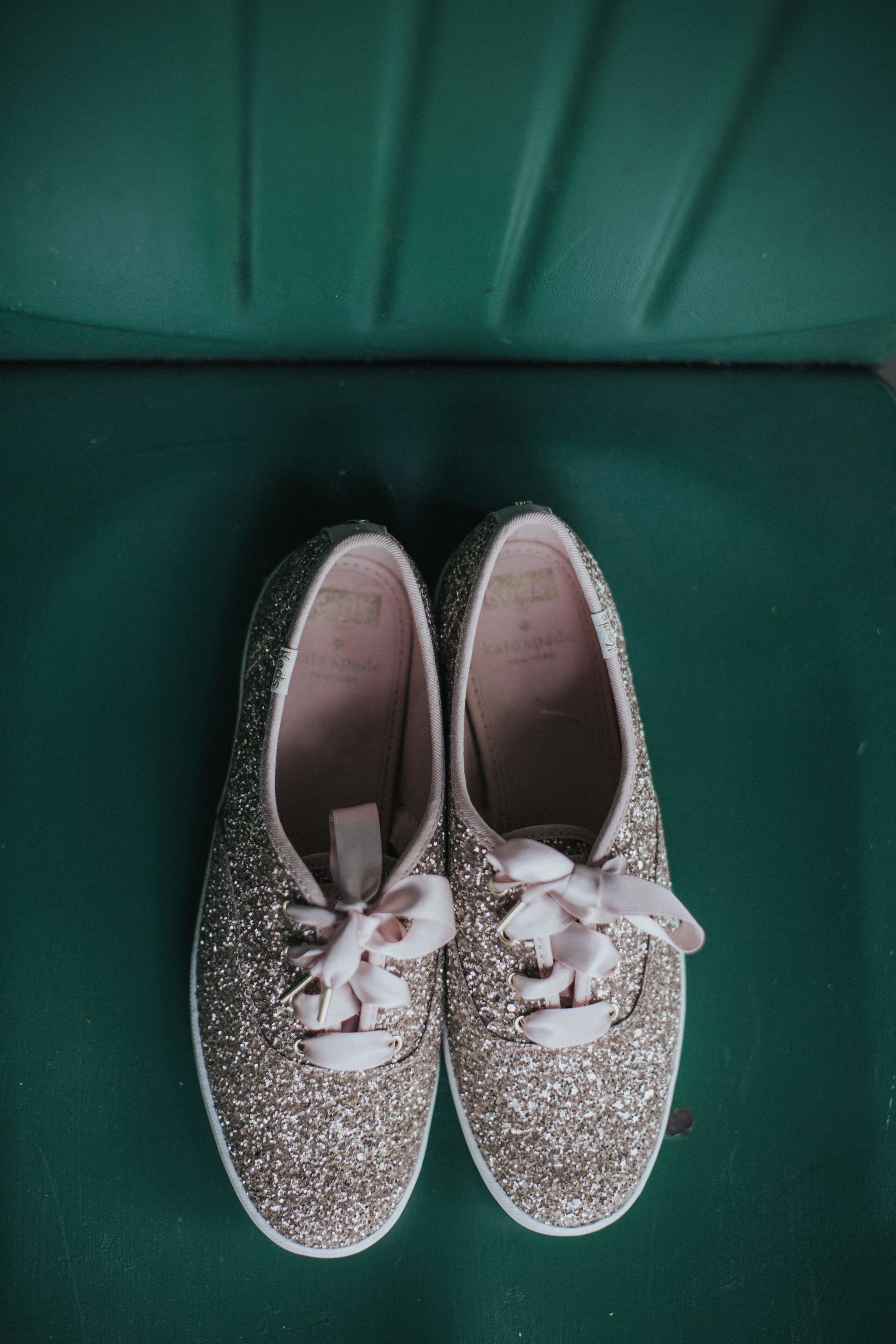 Bride's sparkly wedding sneaker wedding shoes for rustic wedding in Farmington, PA planned by Exhale Events. Find more wedding inspiration at exhale-events.com!