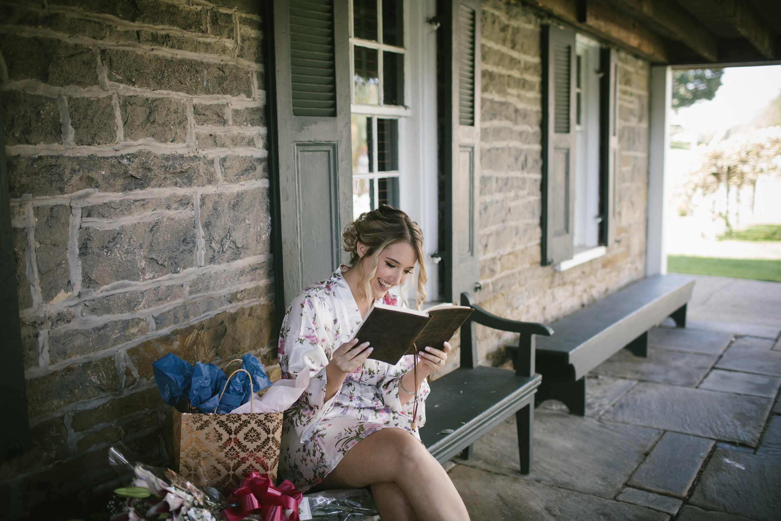 Bride reads letter from groom at rustic wedding in Pittsburgh, PA planned by Exhale Events. Find more wedding inspiration at exhale-events.com!