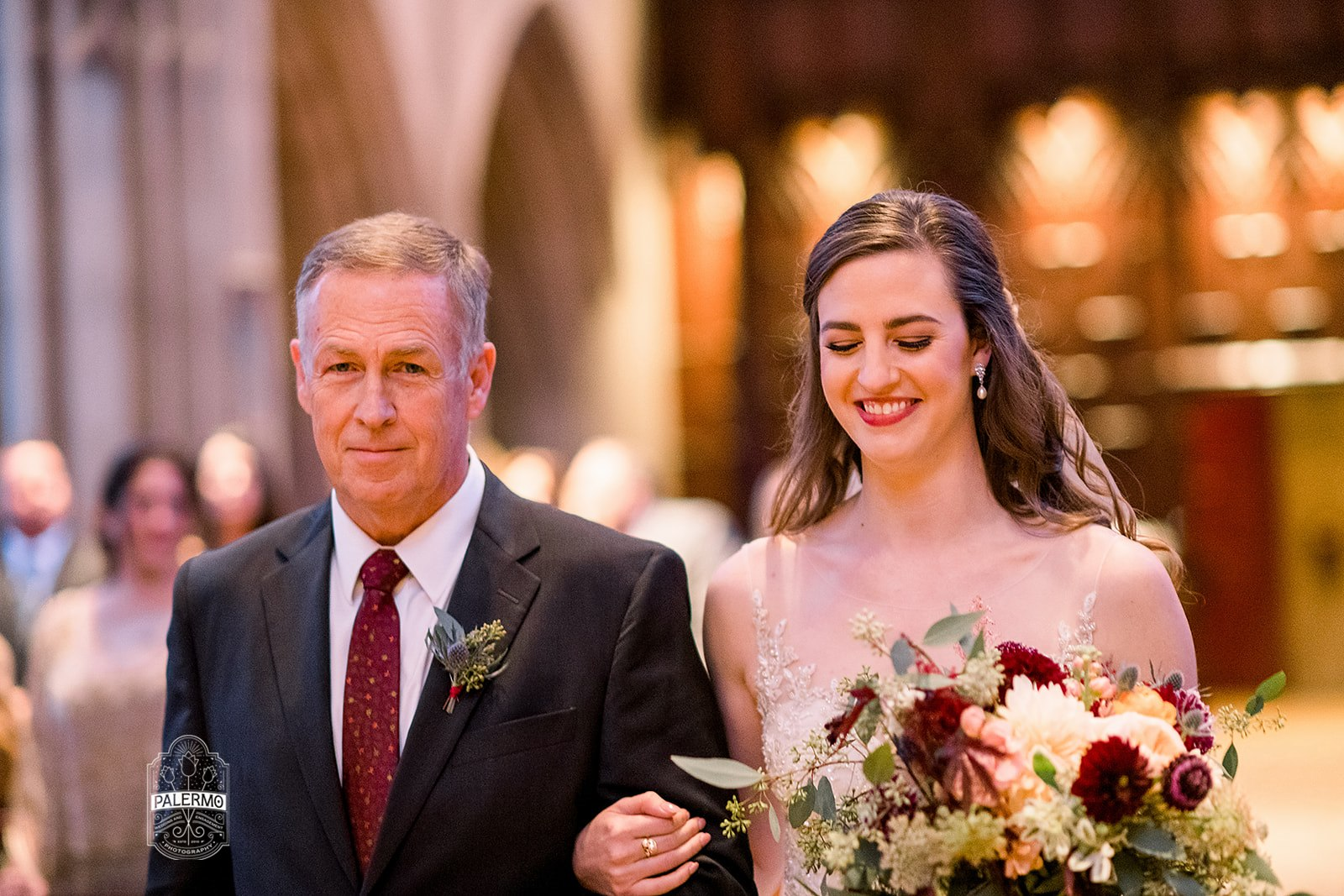 Bride walking down the aisle during wedding ceremony at Heinz Chapel in Pittsburgh, PA planned by Exhale Events. Find more wedding inspiration at exhale-events.com!