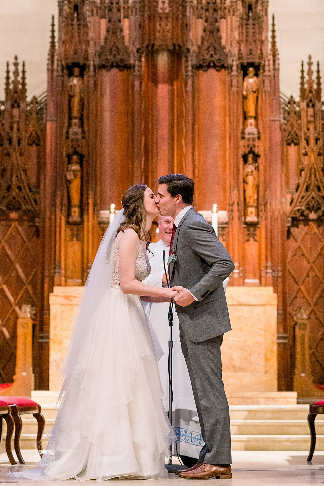 Bride and groom during wedding ceremony at Heinz Chapel in Pittsburgh, PA planned by Exhale Events. Find more wedding inspiration at exhale-events.com!