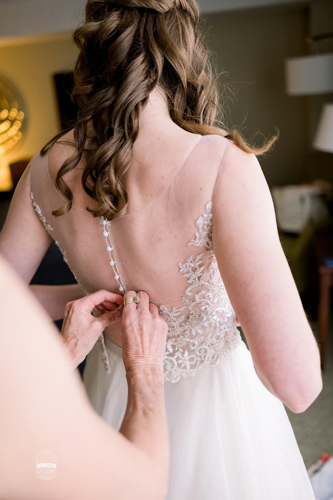 Bride getting into wedding dress with for fall barn wedding in Pittsburgh, PA planned by Exhale Events. Find more wedding inspiration at exhale-events.com!
