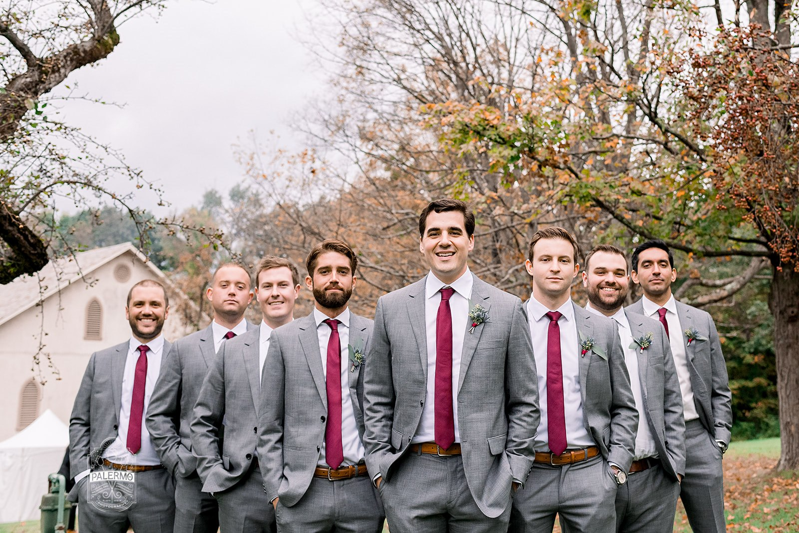 Groom and groomsmen pose for wedding photos in gray suits for fall barn wedding in Pittsburgh, PA planned by Exhale Events. Find more wedding inspiration at exhale-events.com!