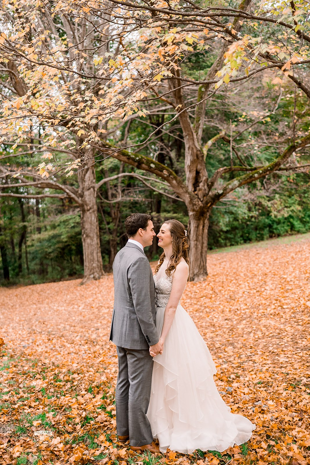 Bride and groom pose for fall outdoor wedding photos for fall barn wedding in Pittsburgh, PA planned by Exhale Events. Find more wedding inspiration at exhale-events.com!