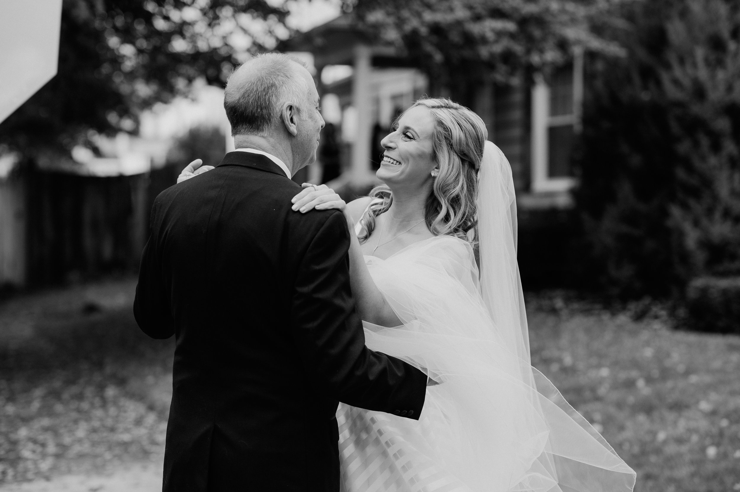Bride and her father share a first look for black, white, and gold wedding in Buffalo, NY planned by Exhale Events. Find more wedding inspiration at exhale-events.com!