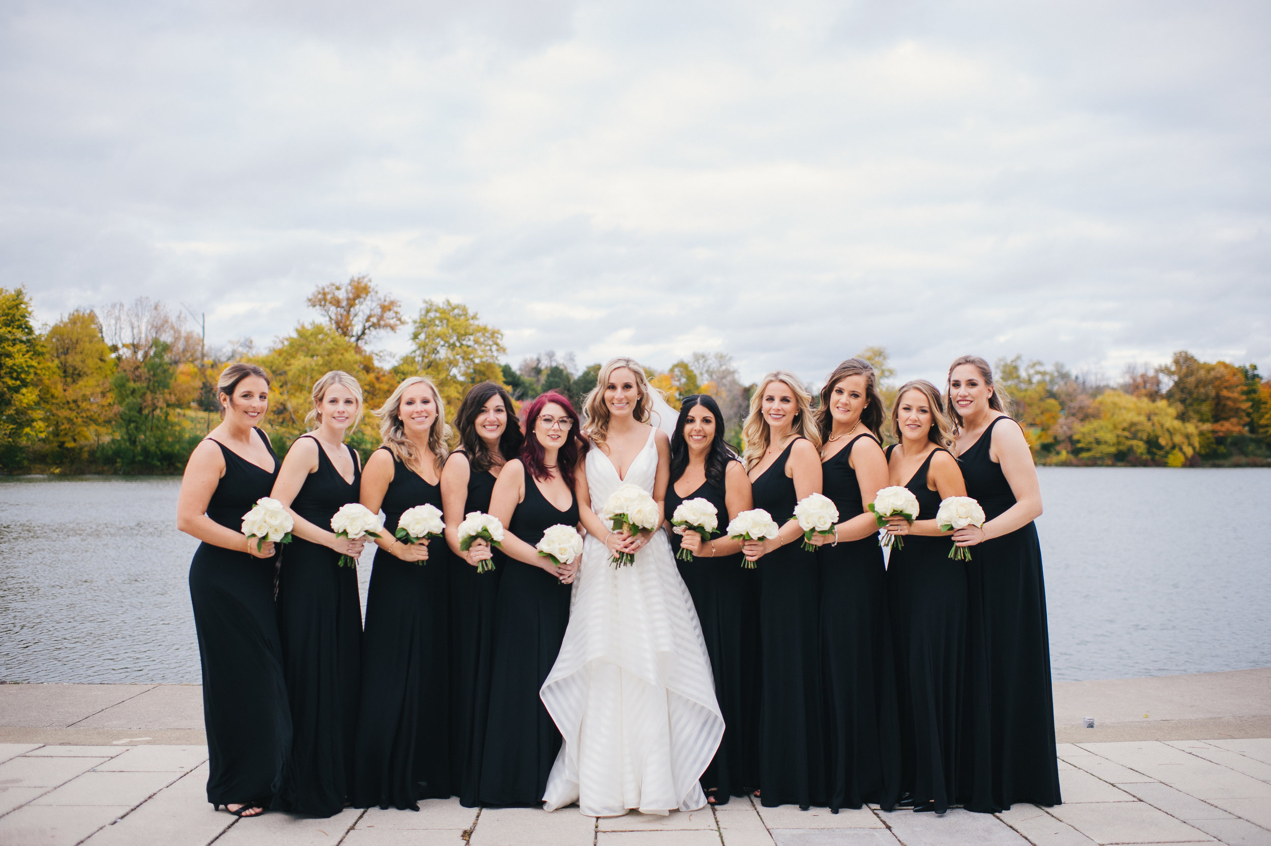 Black bridesmaids dresses and white wedding bouquets for black, white, and gold wedding in Buffalo, NY planned by Exhale Events. Find more wedding inspiration at exhale-events.com!