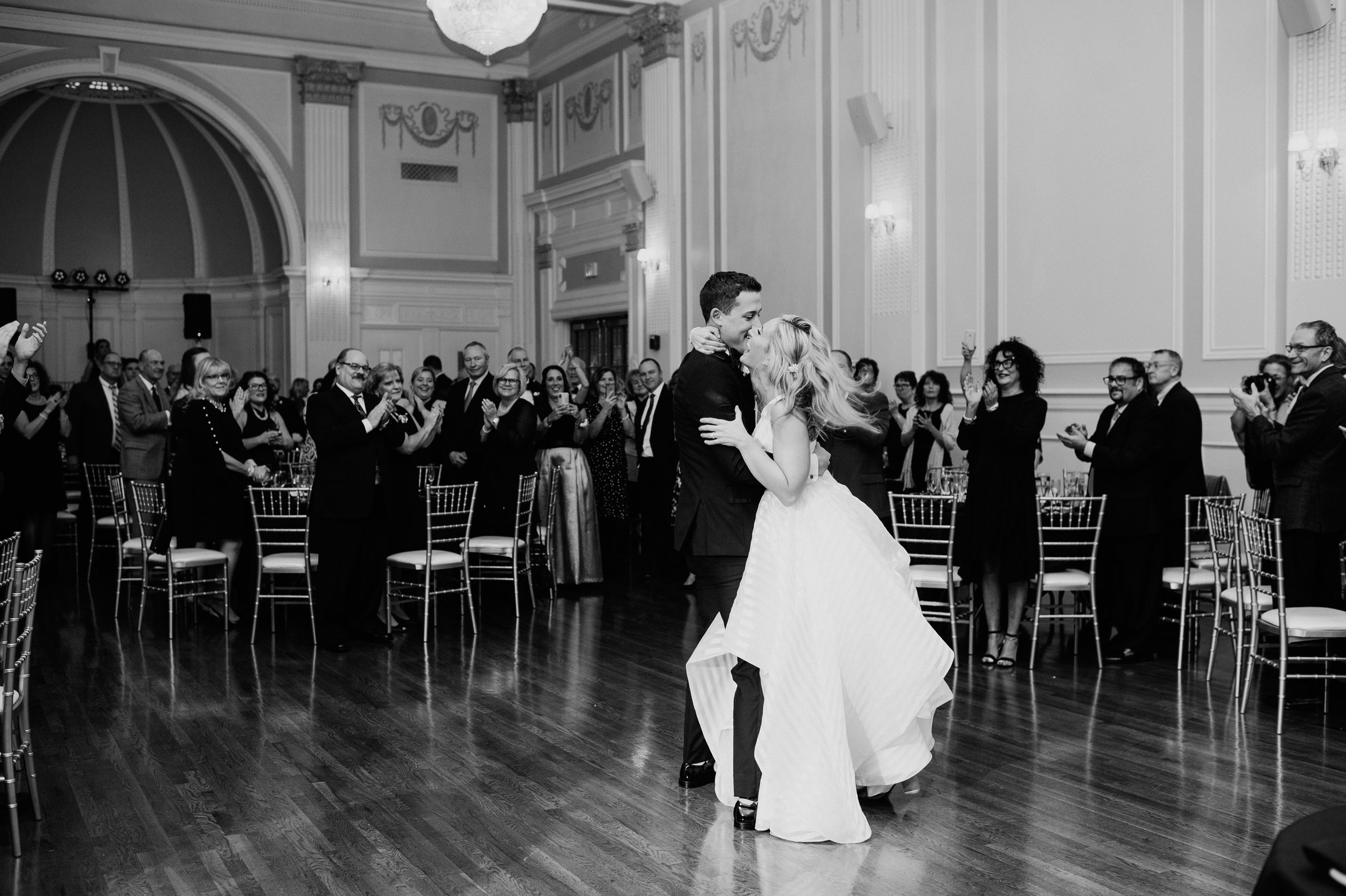 Bride and groom share their first dance for black, white, and gold wedding in Buffalo, NY planned by Exhale Events. Find more wedding inspiration at exhale-events.com!