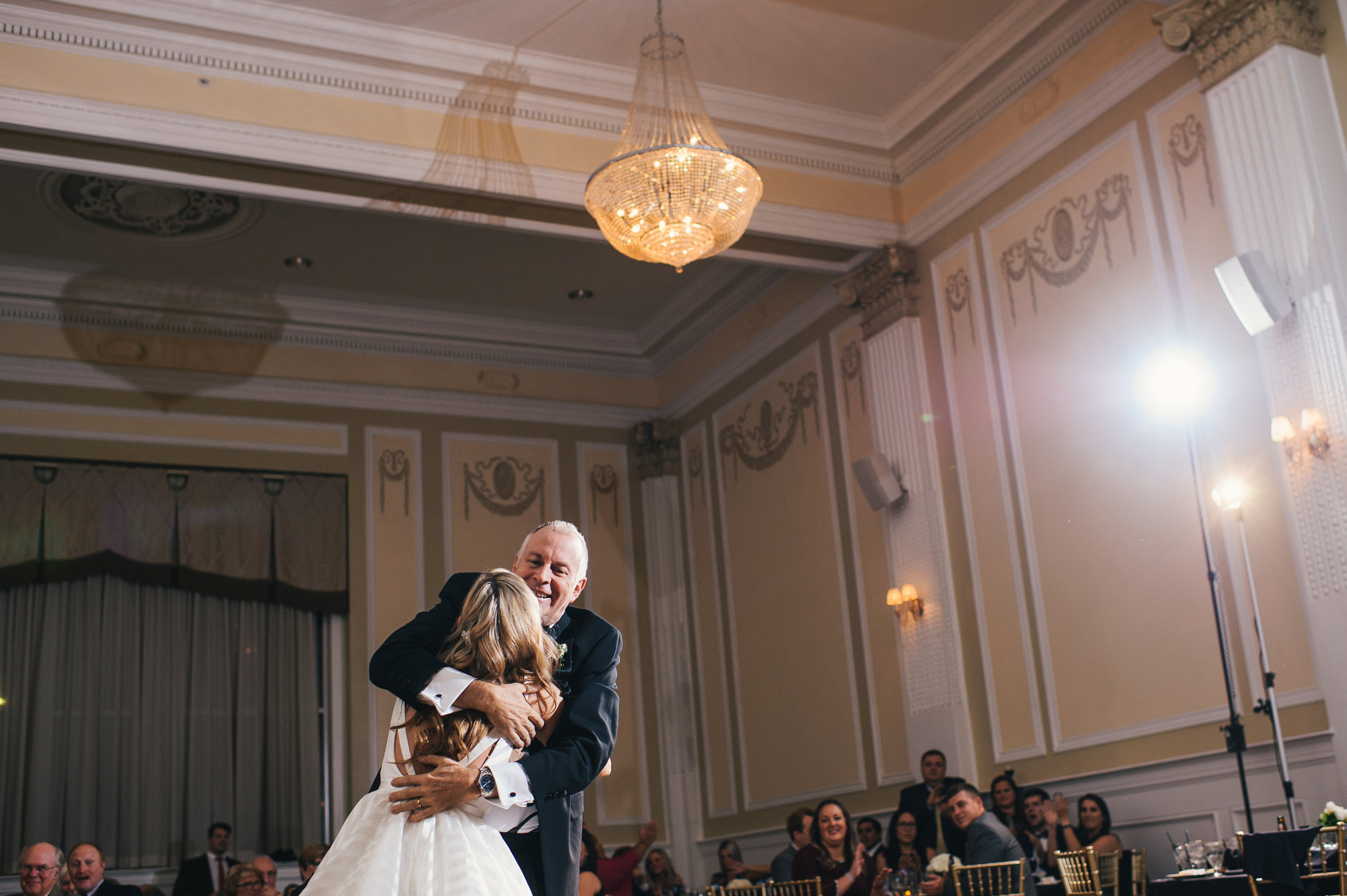 Bride and her father share their father/daughter dance for black, white, and gold wedding in Buffalo, NY planned by Exhale Events. Find more wedding inspiration at exhale-events.com!