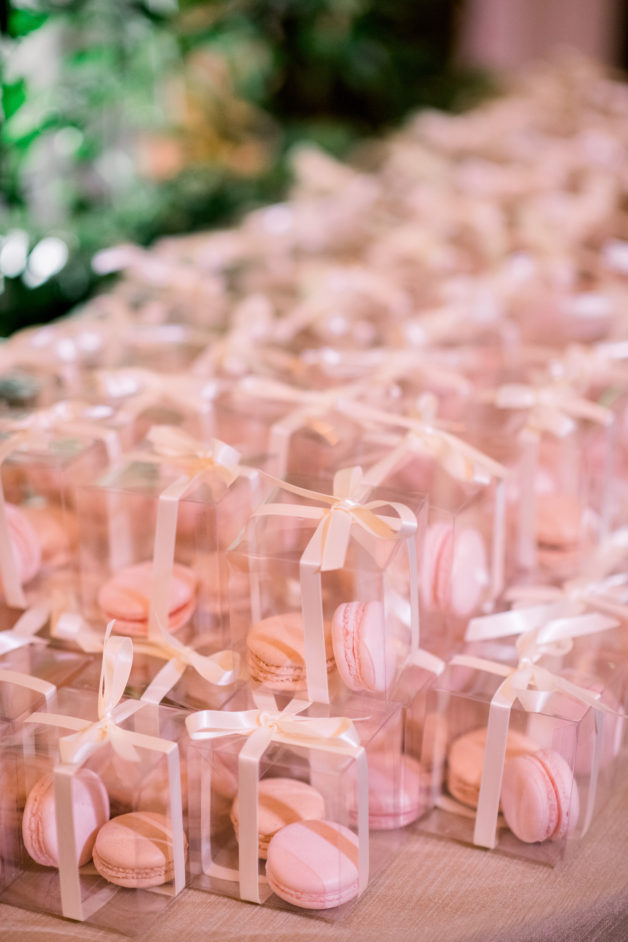 Pink macaron wedding favors for Pittsburgh wedding at Hotel Monaco planned by Exhale Events. Find more modern wedding ideas at exhale-events.com!