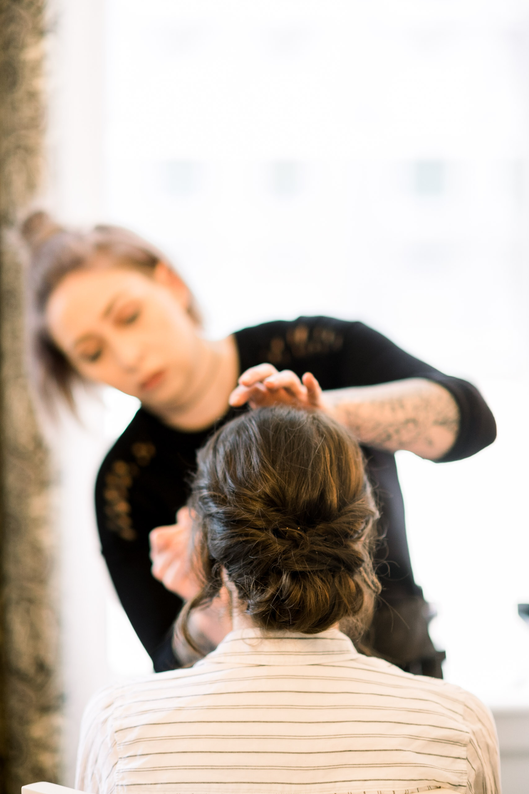 Bride's wedding updo  for Pittsburgh wedding at Hotel Monaco planned by Exhale Events. Find more modern wedding ideas at exhale-events.com!