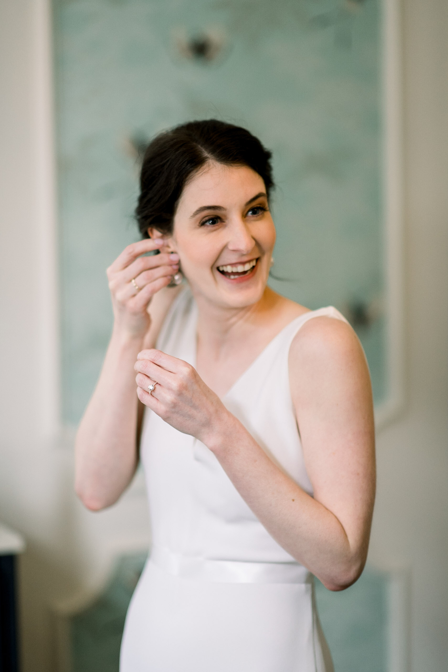 Bride getting ready for Pittsburgh wedding at Hotel Monaco planned by Exhale Events. Find more modern wedding ideas at exhale-events.com!