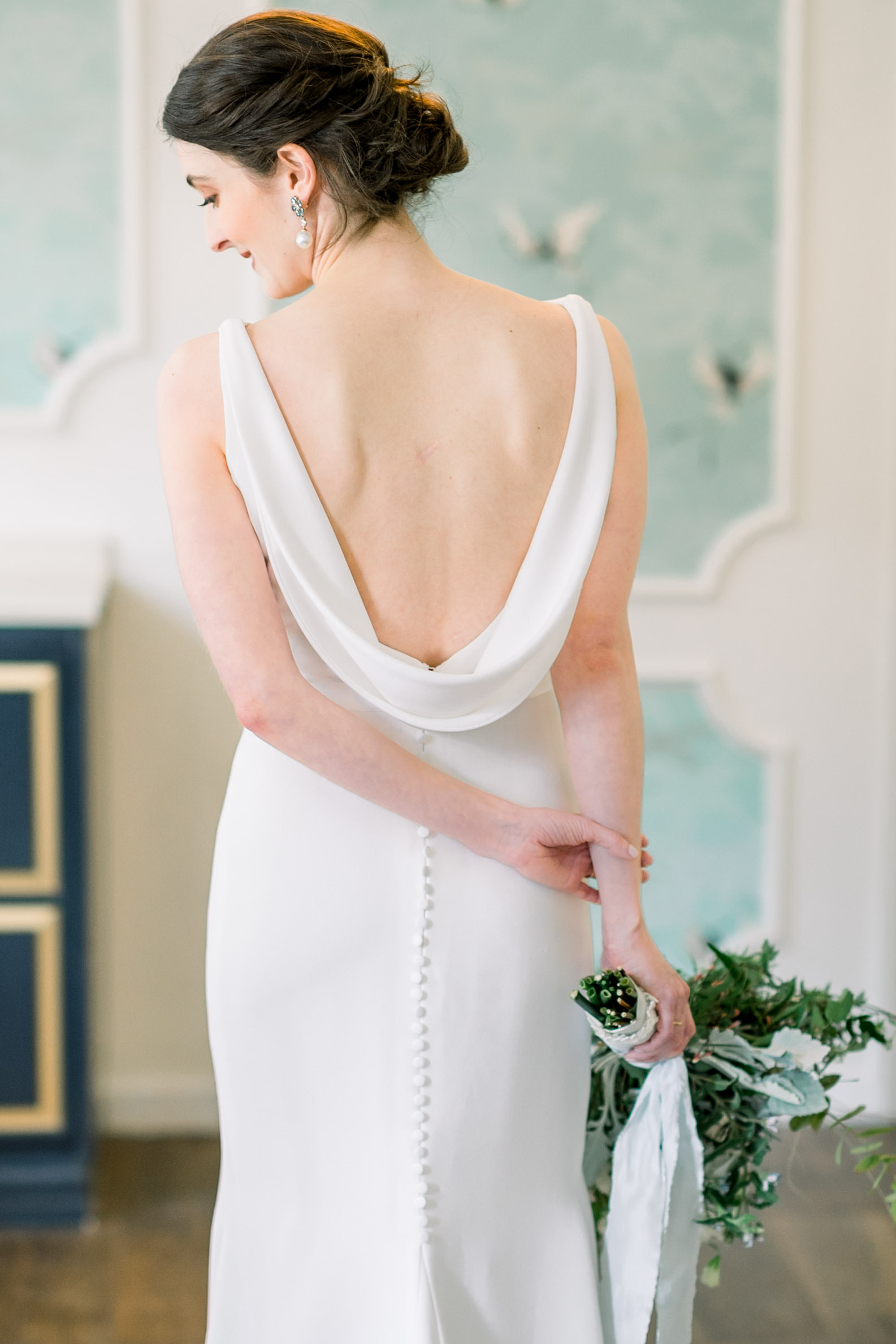 Brides posing for portrait in wedding dress for Pittsburgh wedding at Hotel Monaco planned by Exhale Events. Find more modern wedding ideas at exhale-events.com!