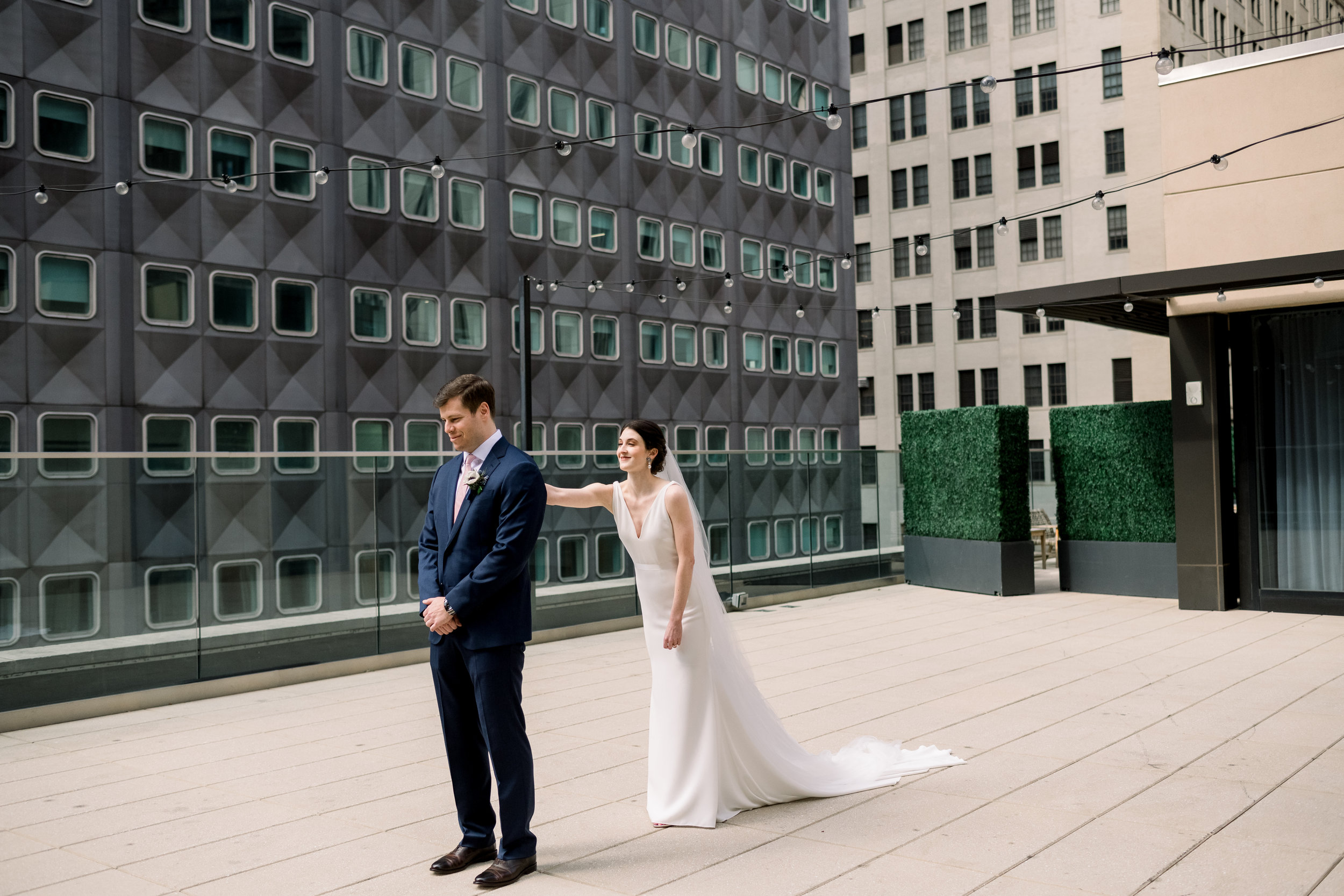 Bride and groom share first look for Pittsburgh wedding at Hotel Monaco planned by Exhale Events. Find more modern wedding ideas at exhale-events.com!