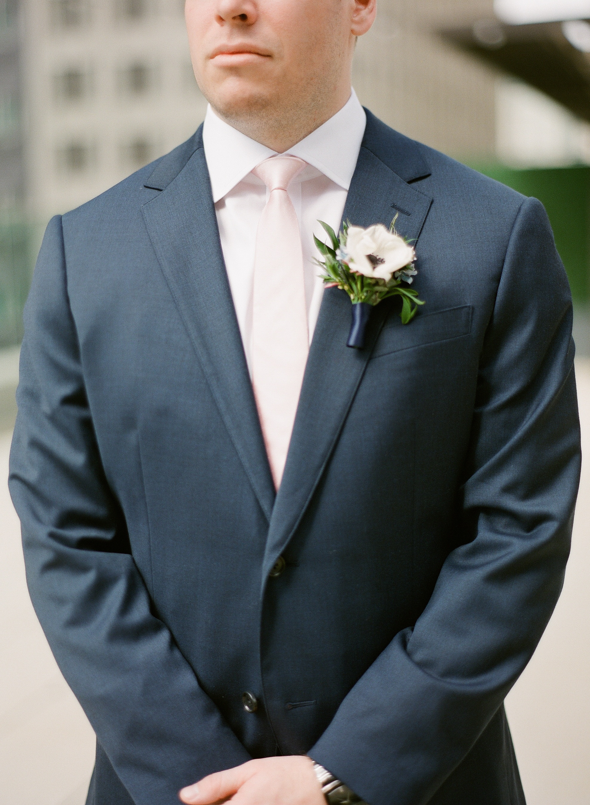 Groom in navy wedding tuxedo with boutonniere for Pittsburgh wedding at Hotel Monaco planned by Exhale Events. Find more modern wedding ideas at exhale-events.com!