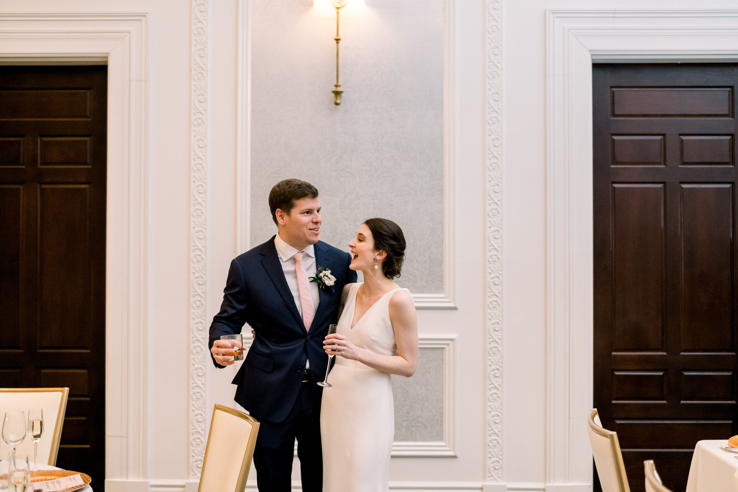 Bride and groom seeing their wedding reception decor for Pittsburgh wedding at Hotel Monaco planned by Exhale Events. Find more modern wedding ideas at exhale-events.com!
