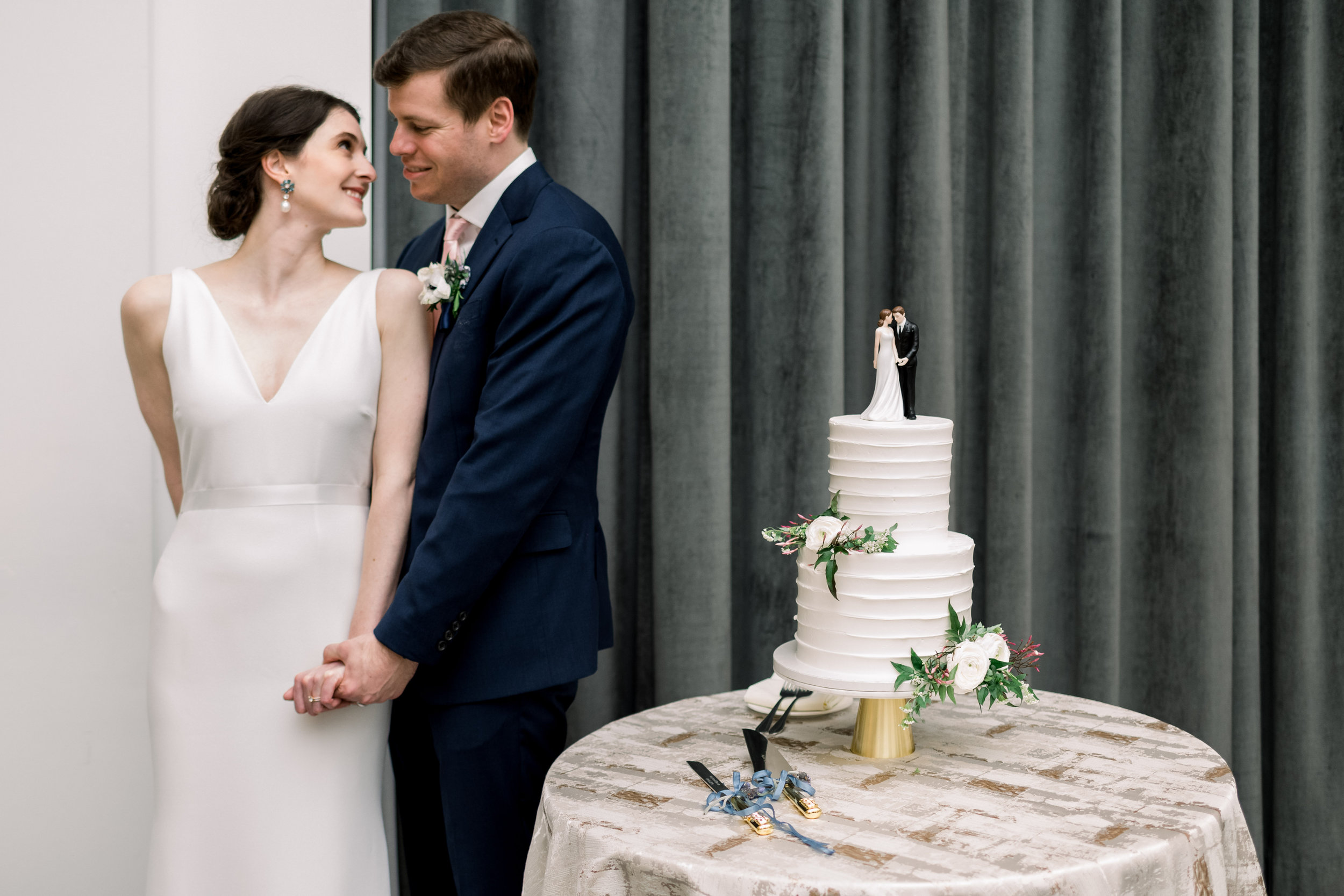 Bride and groom pose for wedding photos for Pittsburgh wedding at Hotel Monaco planned by Exhale Events. Find more modern wedding ideas at exhale-events.com!