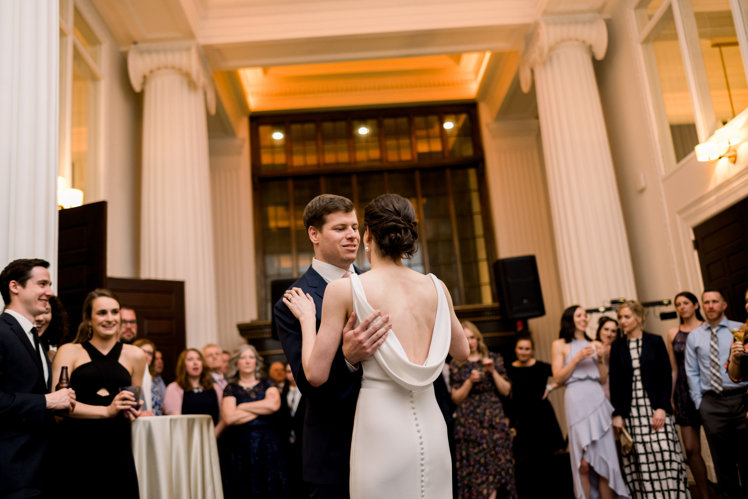 Bride and groom share first dance at Pittsburgh wedding at Hotel Monaco planned by Exhale Events. Find more modern wedding ideas at exhale-events.com!