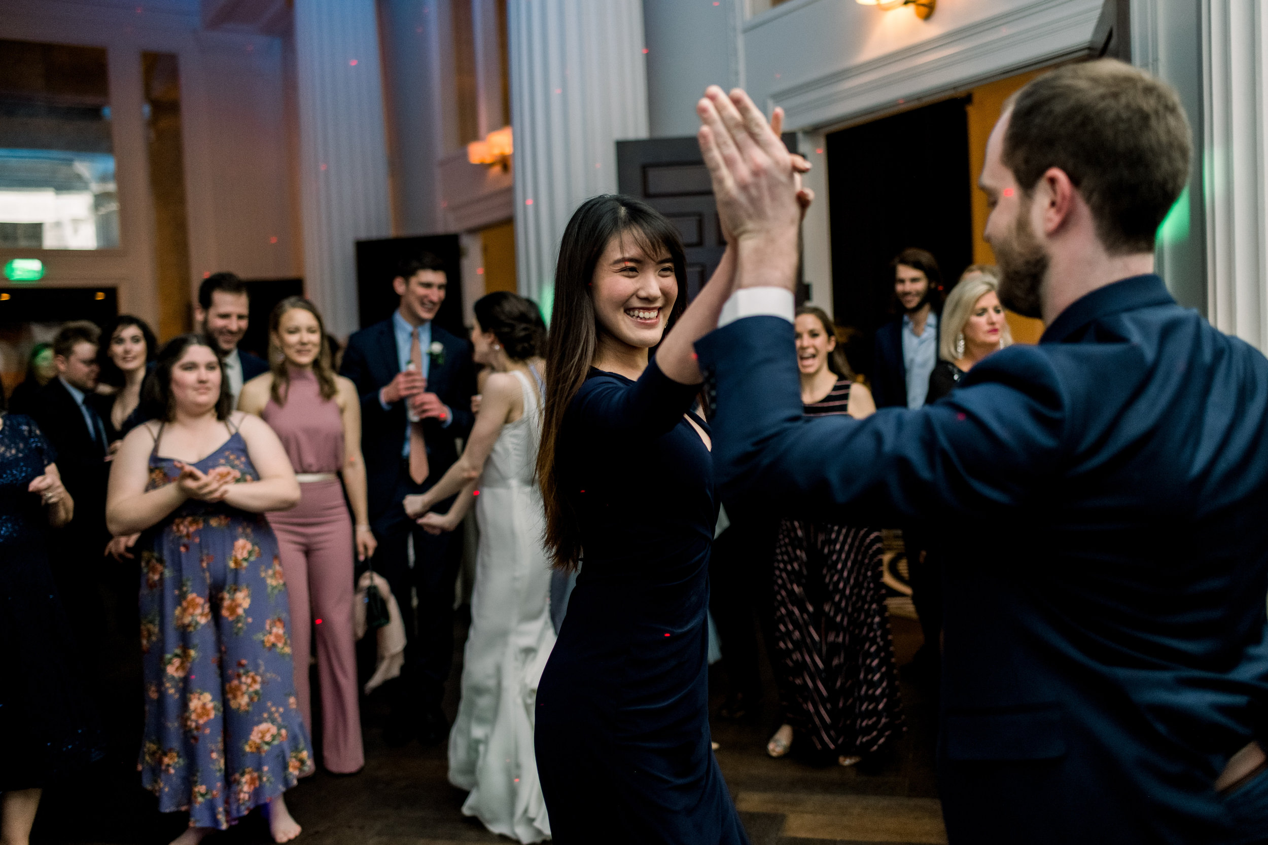 Bride and groom dancing with guests at Pittsburgh wedding at Hotel Monaco planned by Exhale Events. Find more modern wedding ideas at exhale-events.com!