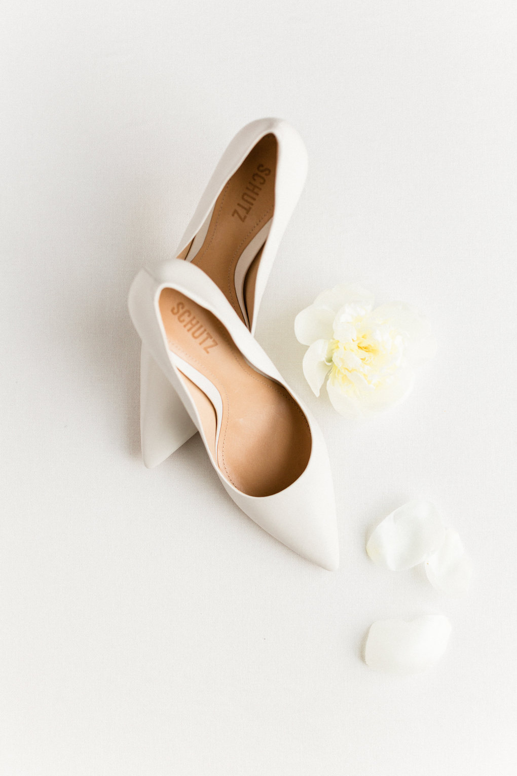 White wedding shoes for chic wedding in Buffalo, NY planned by Exhale Events. Find more timeless wedding inspiration at exhale-events.com!