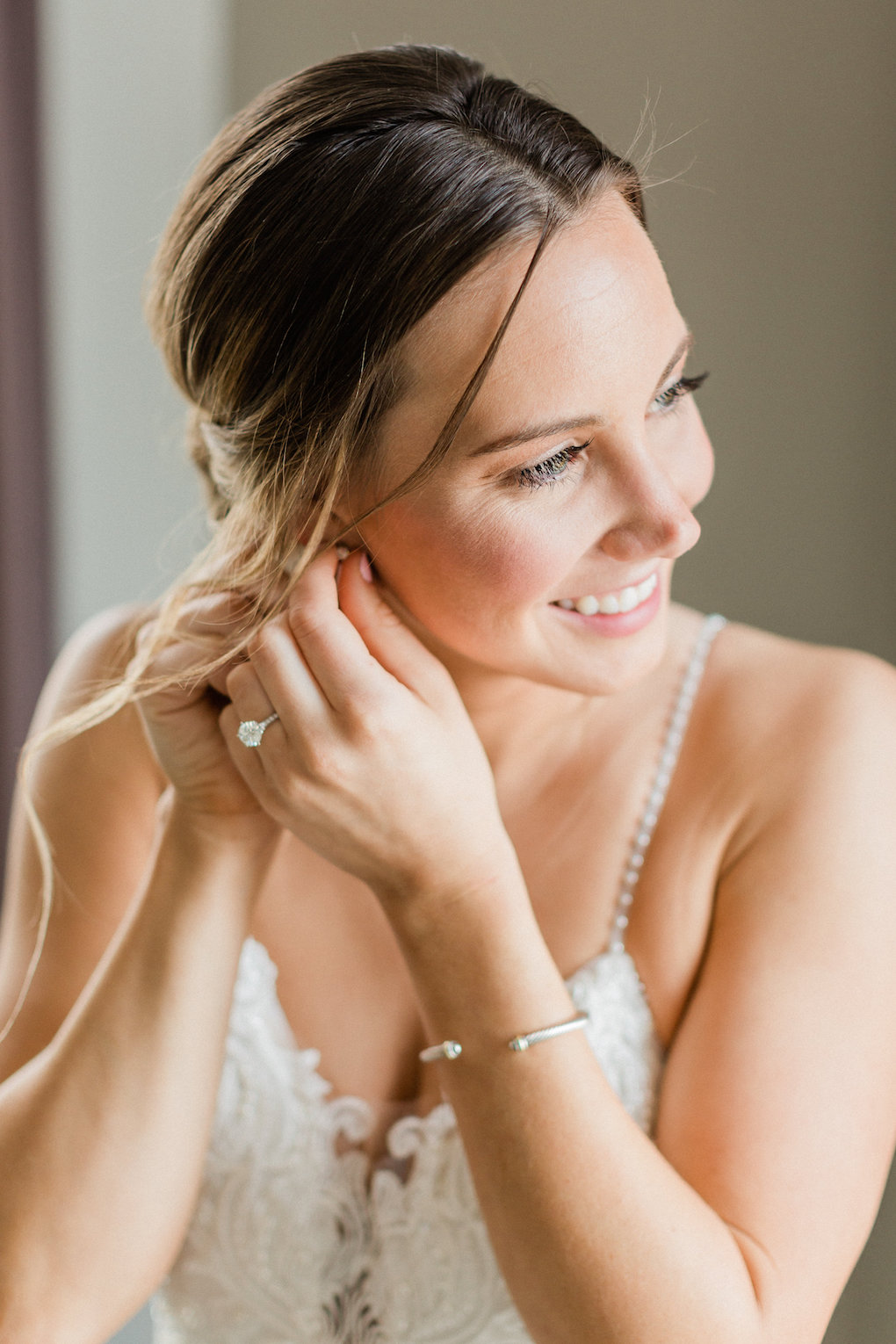 Bride getting ready for chic wedding in Buffalo, NY planned by Exhale Events. Find more timeless wedding inspiration at exhale-events.com!