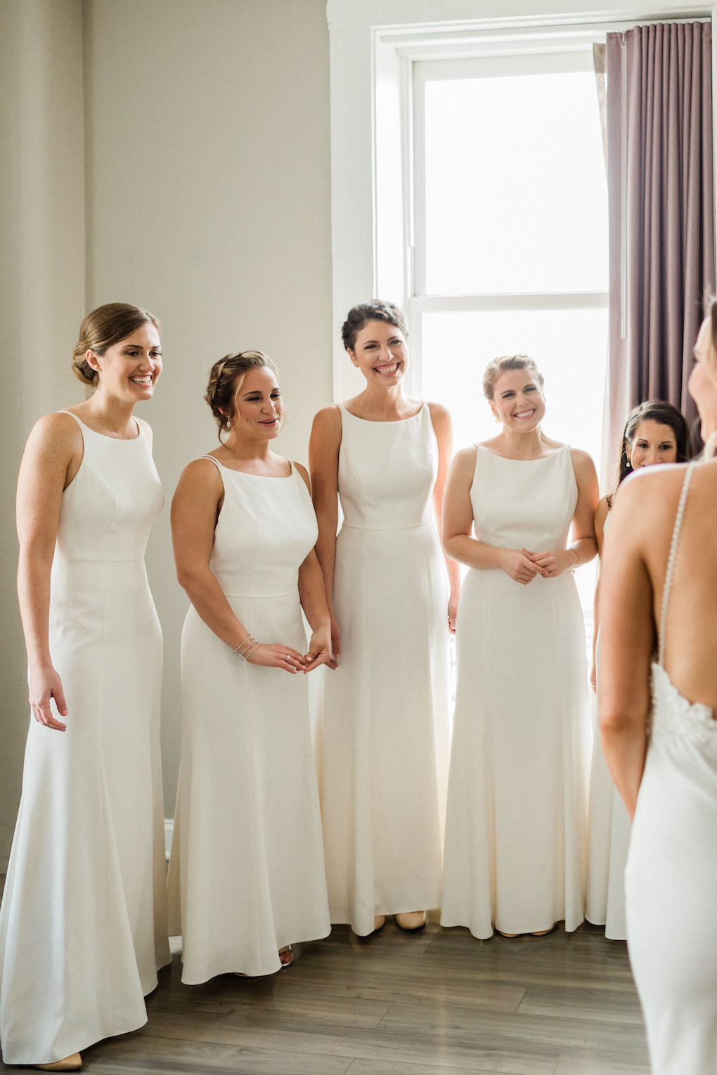 White bridesmaids dresses for chic wedding in Buffalo, NY planned by Exhale Events. Find more timeless wedding inspiration at exhale-events.com!