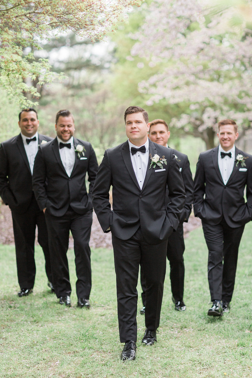 Groom and groomsmen pose for wedding photos for chic wedding in Buffalo, NY planned by Exhale Events. Find more timeless wedding inspiration at exhale-events.com!