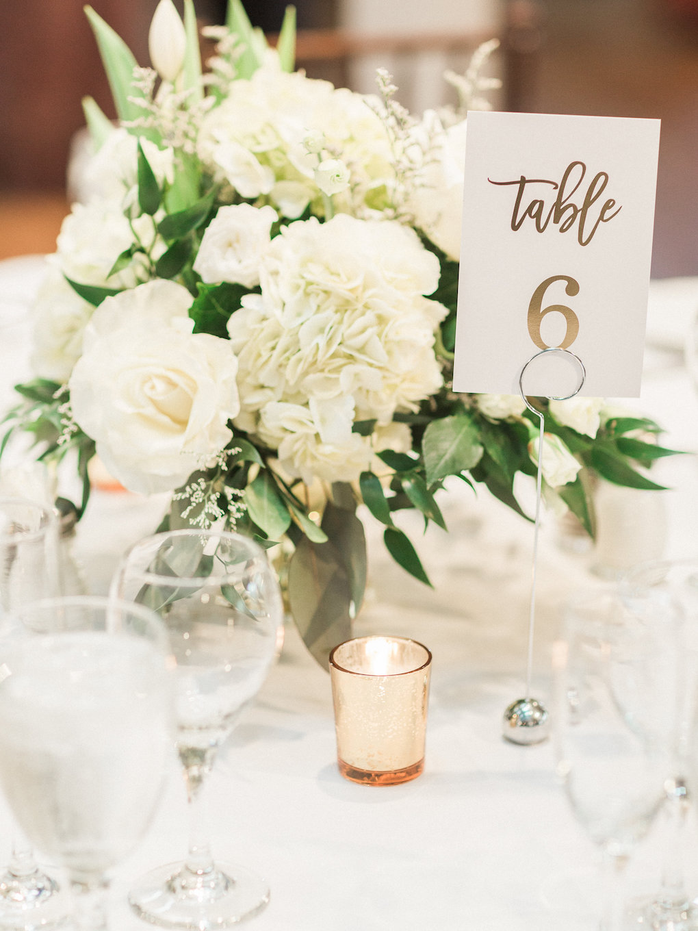 White and greenery wedding centerpieces for chic wedding in Buffalo, NY planned by Exhale Events. Find more timeless wedding inspiration at exhale-events.com!