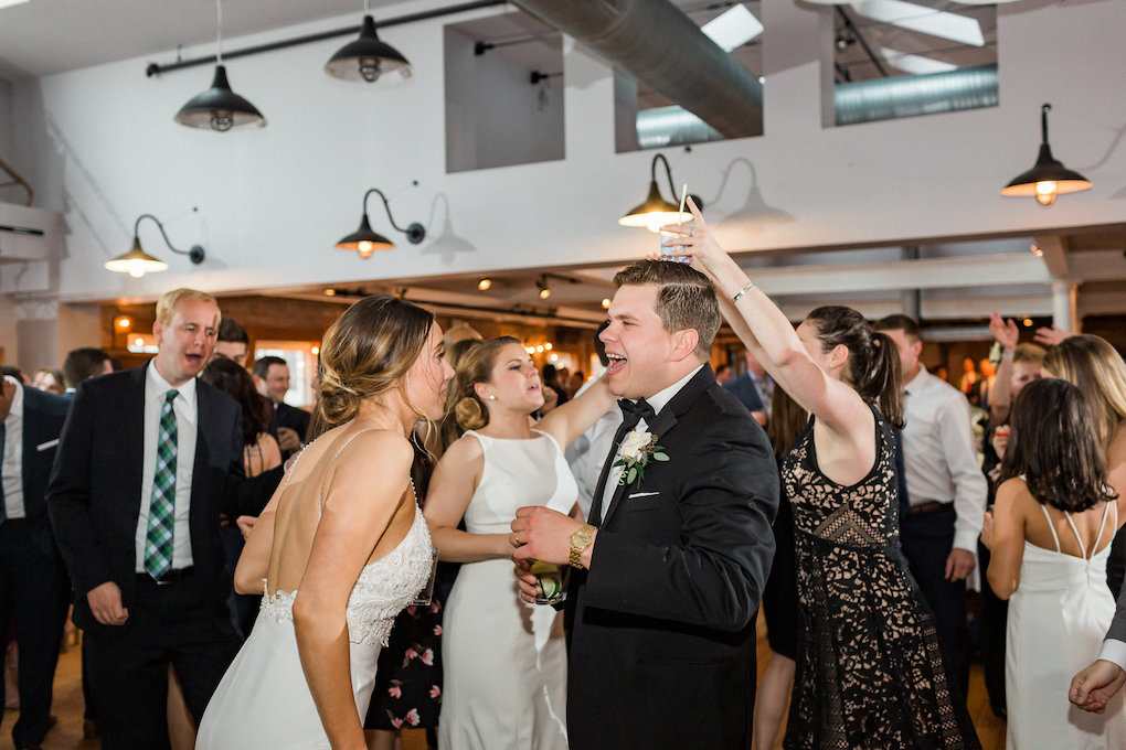 Bride and groom dancing at chic wedding in Buffalo, NY planned by Exhale Events. Find more timeless wedding inspiration at exhale-events.com!
