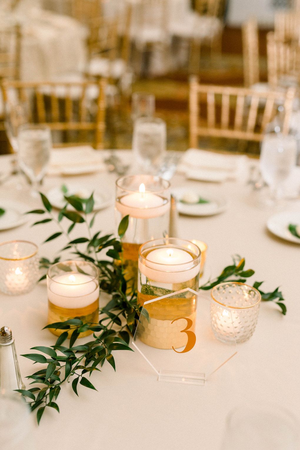 Greenery and gold wedding centerpieces: Romantic Fairytale wedding at the Omni William Penn in Pittsburgh, PA planned by Exhale Events. Find more wedding inspiration at exhale-events.com!