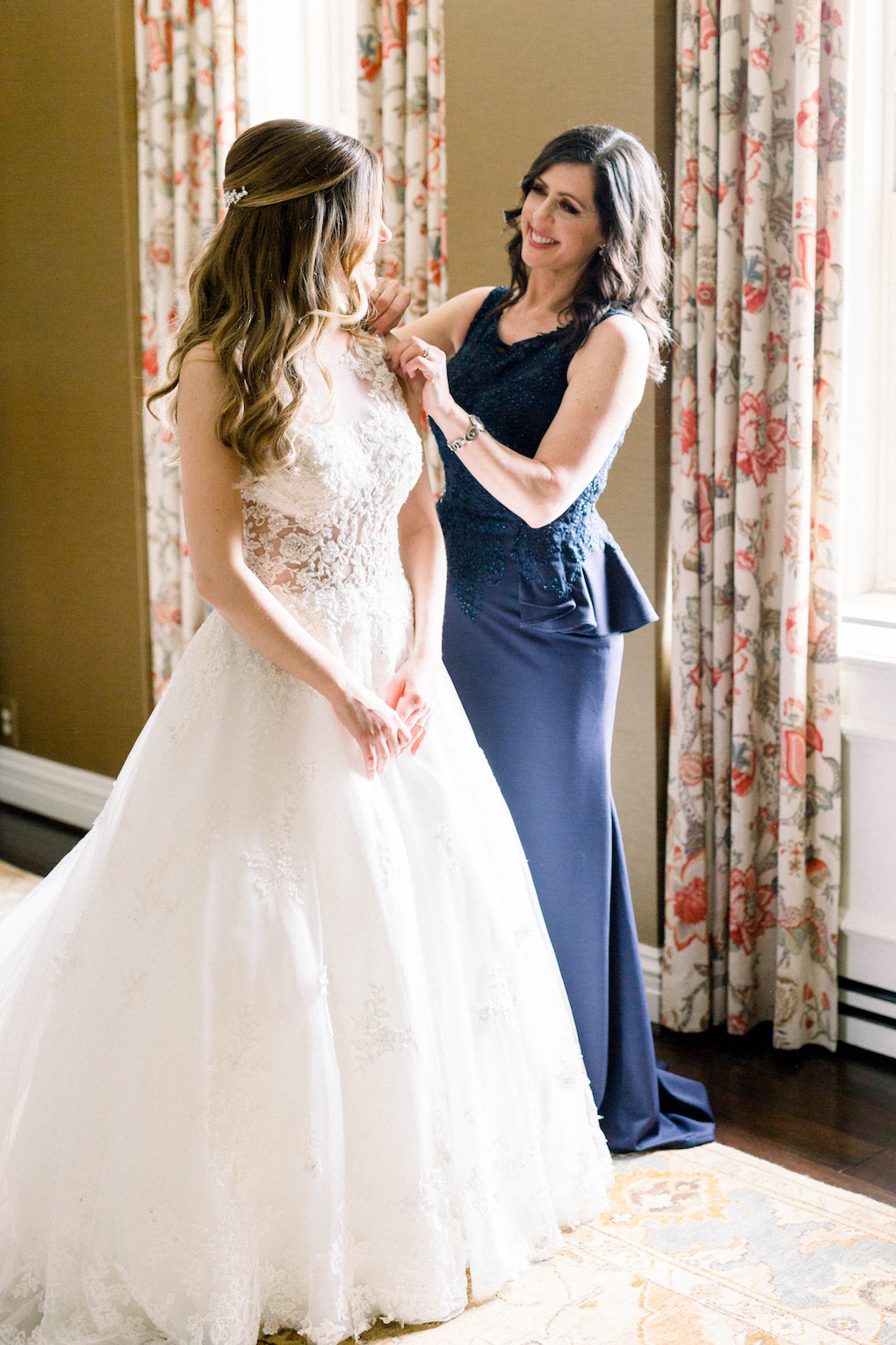 Bride getting into wedding dress: Romantic Fairytale wedding at the Omni William Penn in Pittsburgh, PA planned by Exhale Events. Find more wedding inspiration at exhale-events.com!