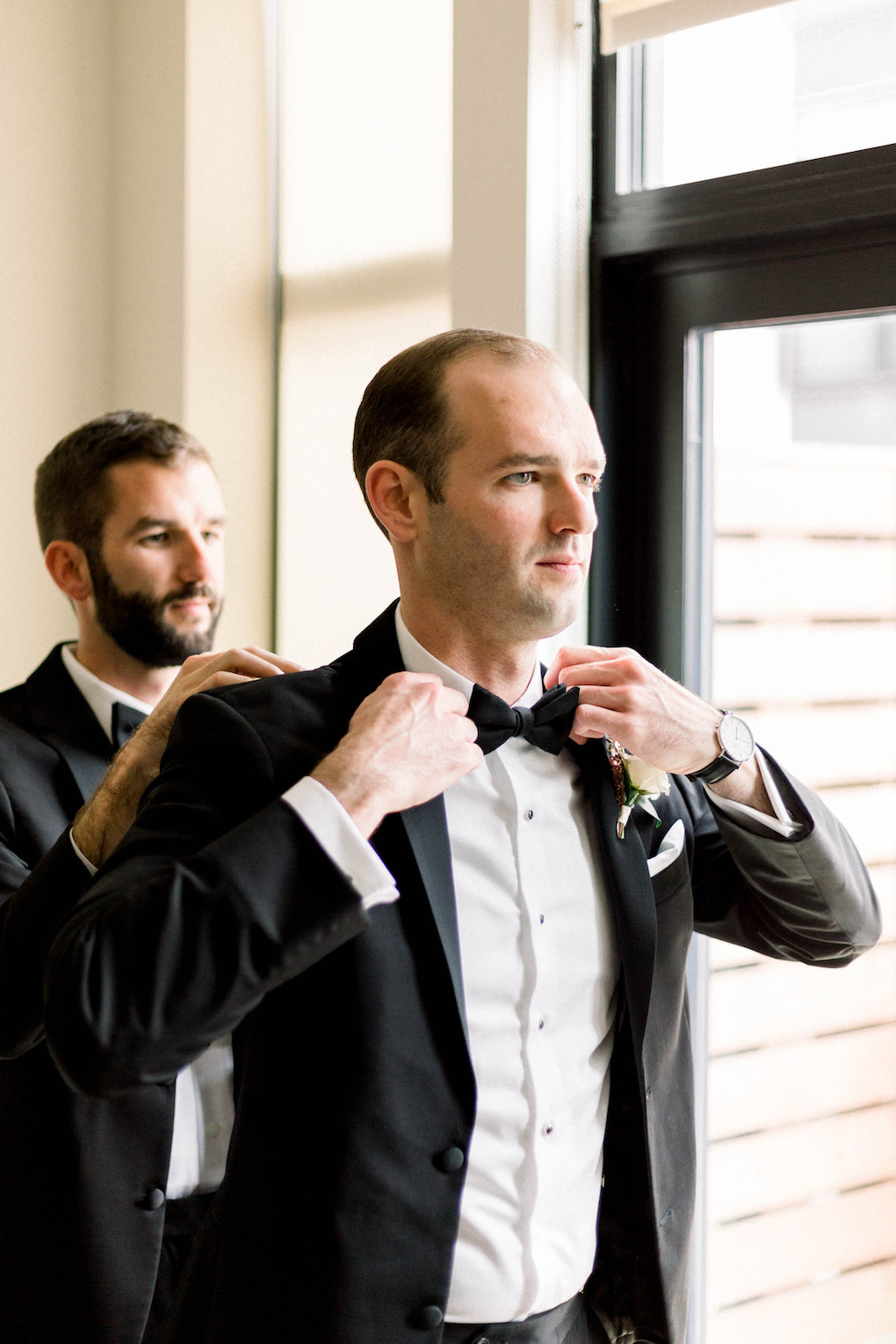 Groom getting ready in black tuxedo: Romantic Fairytale wedding at the Omni William Penn in Pittsburgh, PA planned by Exhale Events. Find more wedding inspiration at exhale-events.com!
