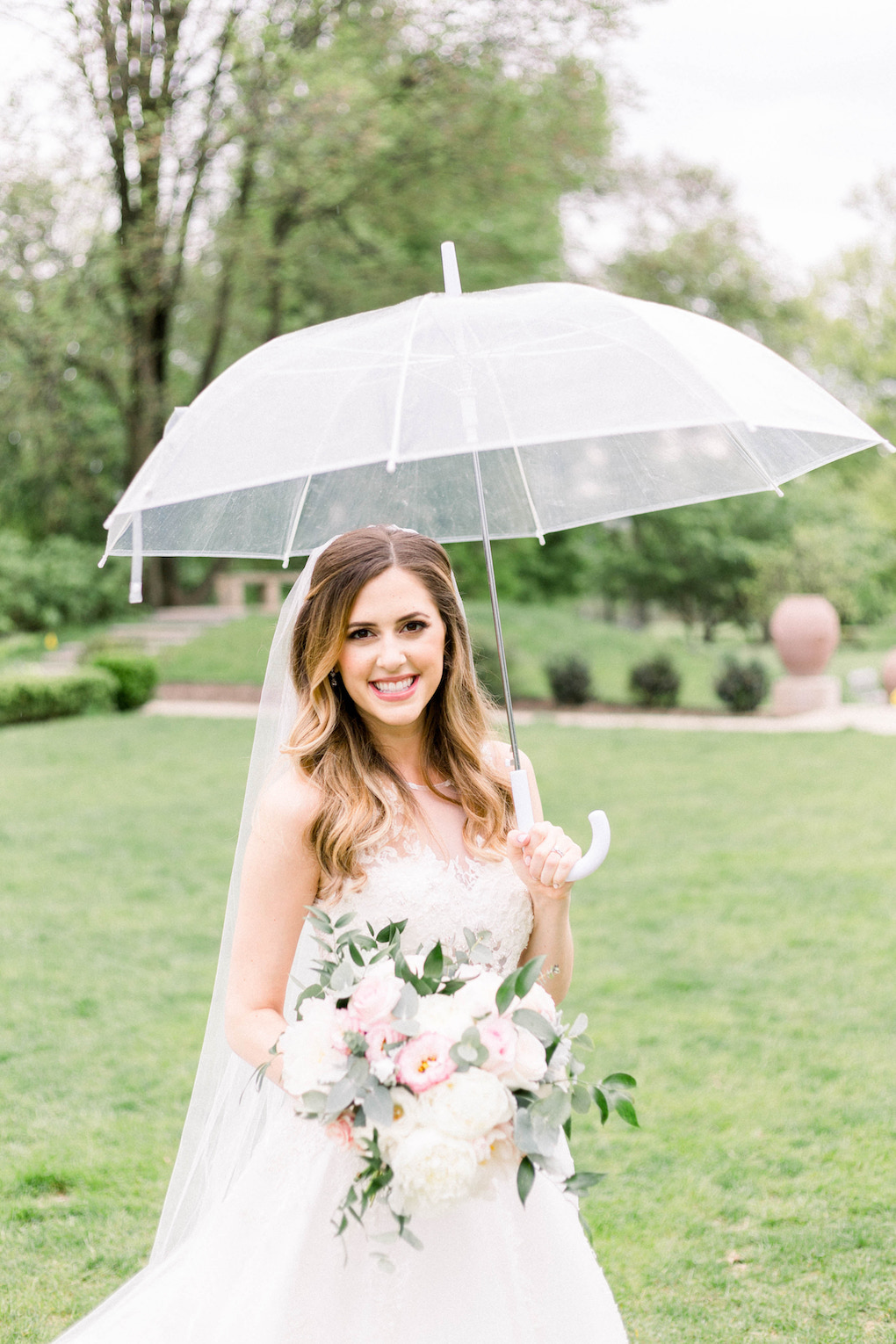 Bridal portrait with umbrella: Romantic Fairytale wedding at the Omni William Penn in Pittsburgh, PA planned by Exhale Events. Find more wedding inspiration at exhale-events.com!