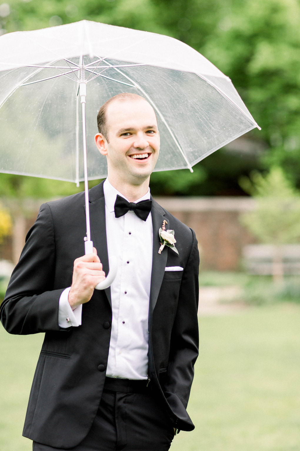 Groom posing with umbrella: Romantic Fairytale wedding at the Omni William Penn in Pittsburgh, PA planned by Exhale Events. Find more wedding inspiration at exhale-events.com!