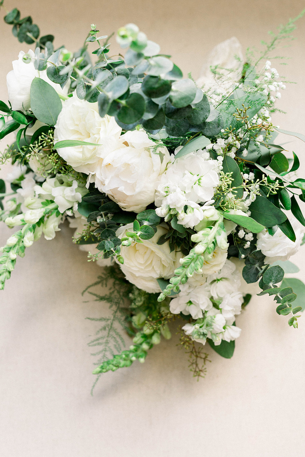 White and green wedding bouquet: Pittsburgh Botanic Garden wedding planned by Exhale Events. See more wedding inspiration at exhale-events.com!