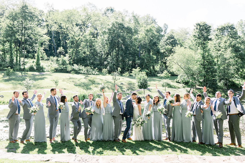 Fun wedding party photos with large bridal party: Pittsburgh Botanic Garden wedding planned by Exhale Events. See more wedding inspiration at exhale-events.com!