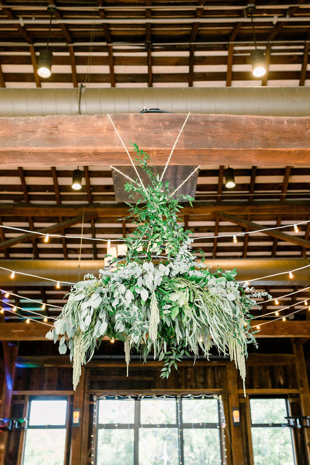 Floral greenery chandelier: Pittsburgh Botanic Garden wedding planned by Exhale Events. See more wedding inspiration at exhale-events.com!