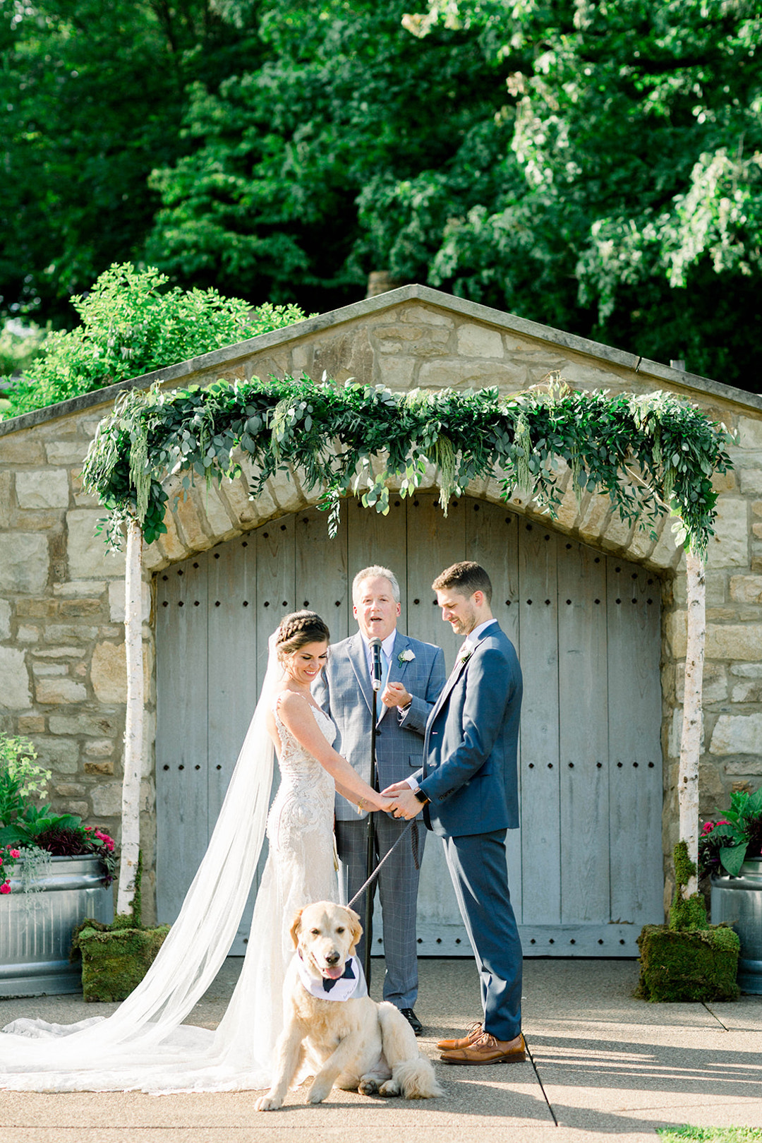 Beautiful wood and greenery ceremony arch: Sunset wedding photos:Pittsburgh Botanic Garden wedding planned by Exhale Events. See more wedding inspiration at exhale-events.com!