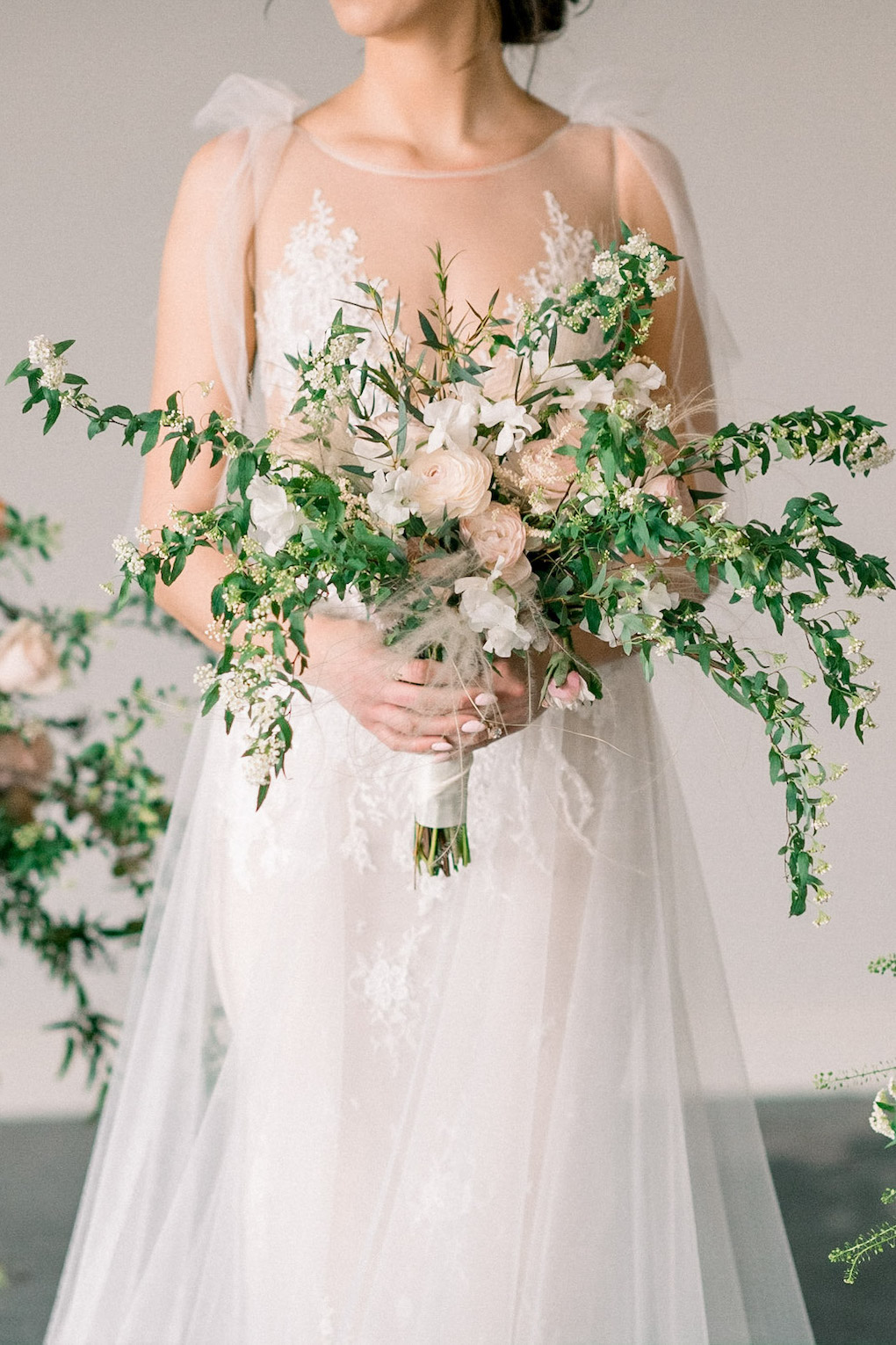 Loose and modern wedding bouquet: Soft and Subtle Palettes of Spring Blossoms | Editorial Shoot at The Renaissance Pittsburgh by Exhale Events. See more inspiration at exhale-events.com!