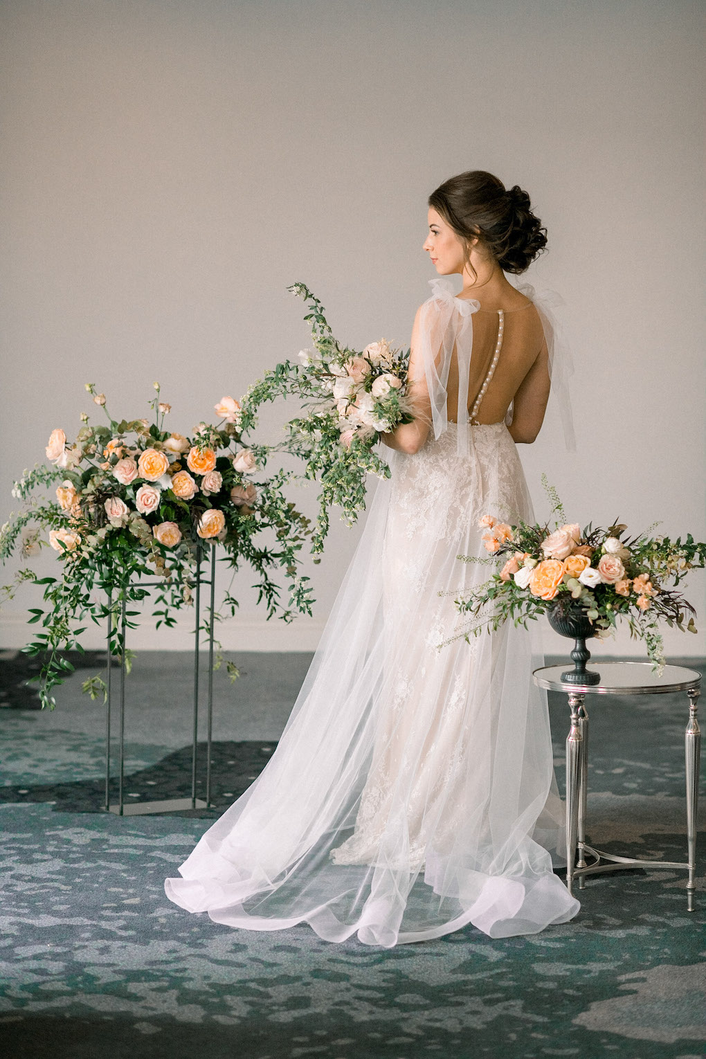 Wedding dress with soft bows: Soft and Subtle Palettes of Spring Blossoms | Editorial Shoot at The Renaissance Pittsburgh by Exhale Events. See more inspiration at exhale-events.com!