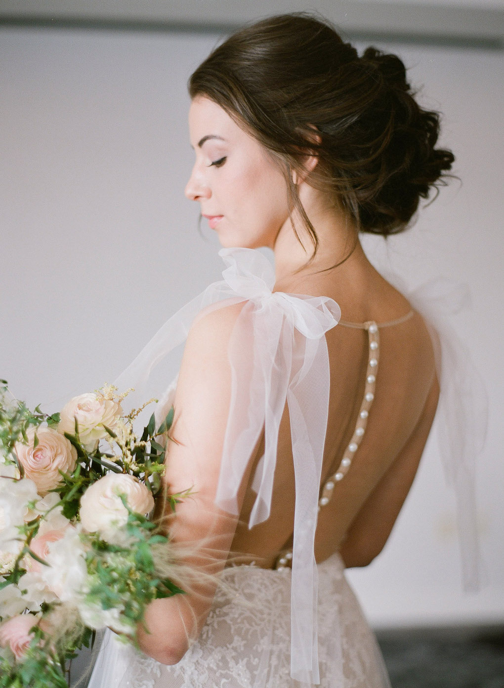 Gorgeous wedding dress details: Soft and Subtle Palettes of Spring Blossoms | Editorial Shoot at The Renaissance Pittsburgh by Exhale Events. See more inspiration at exhale-events.com!