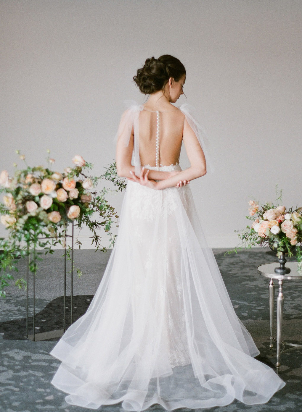 Wedding dress details with pearls: Soft and Subtle Palettes of Spring Blossoms | Editorial Shoot at The Renaissance Pittsburgh by Exhale Events. See more inspiration at exhale-events.com!