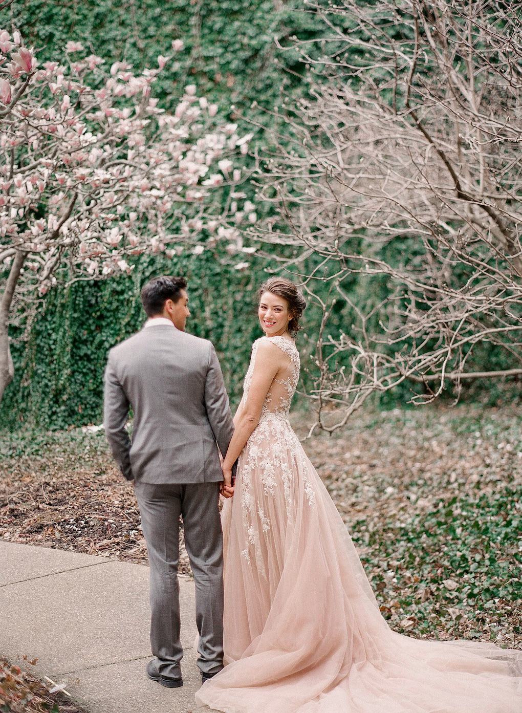 Bride and groom in blush wedding dress:Soft and Subtle Palettes of Spring Blossoms | Editorial Shoot at The Renaissance Pittsburgh by Exhale Events. See more inspiration at exhale-events.com!