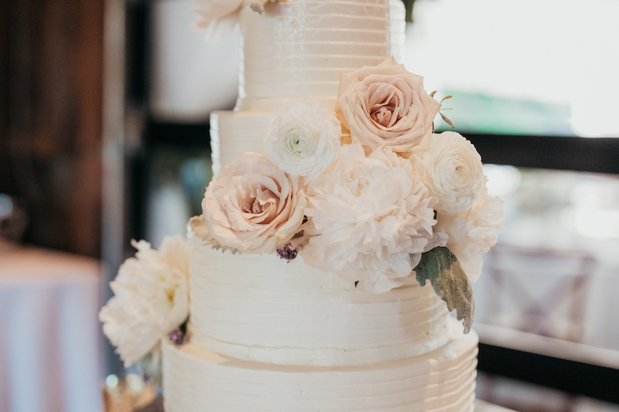 Gorgeous flowers on a classic wedding cake: Elegant and Classic Garden Wedding planned by Exhale Events. See more at exhale-events.com!
