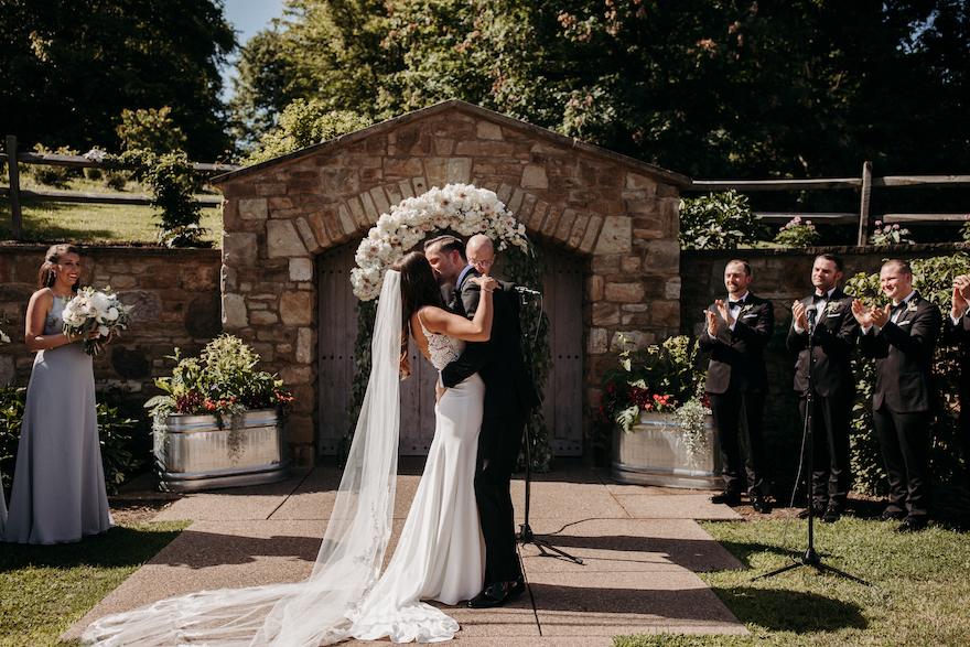 Beautiful first Kiss shot of bride and groom: Elegant and Classic Garden Wedding planned by Exhale Events. See more at exhale-events.com!