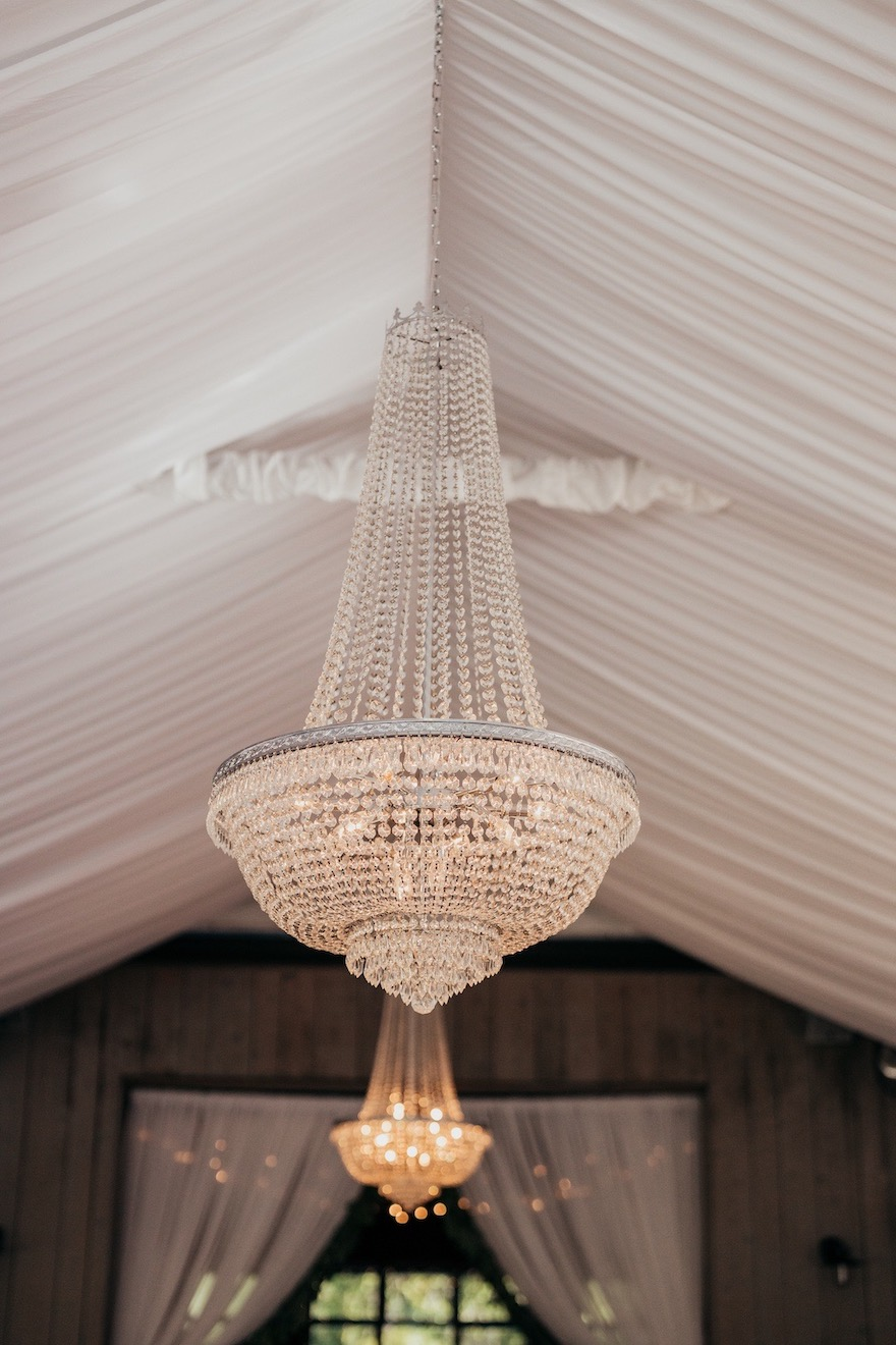 Beautiful crystal chandelier for outdoor wedding: Elegant and Classic Garden Wedding planned by Exhale Events. See more at exhale-events.com!