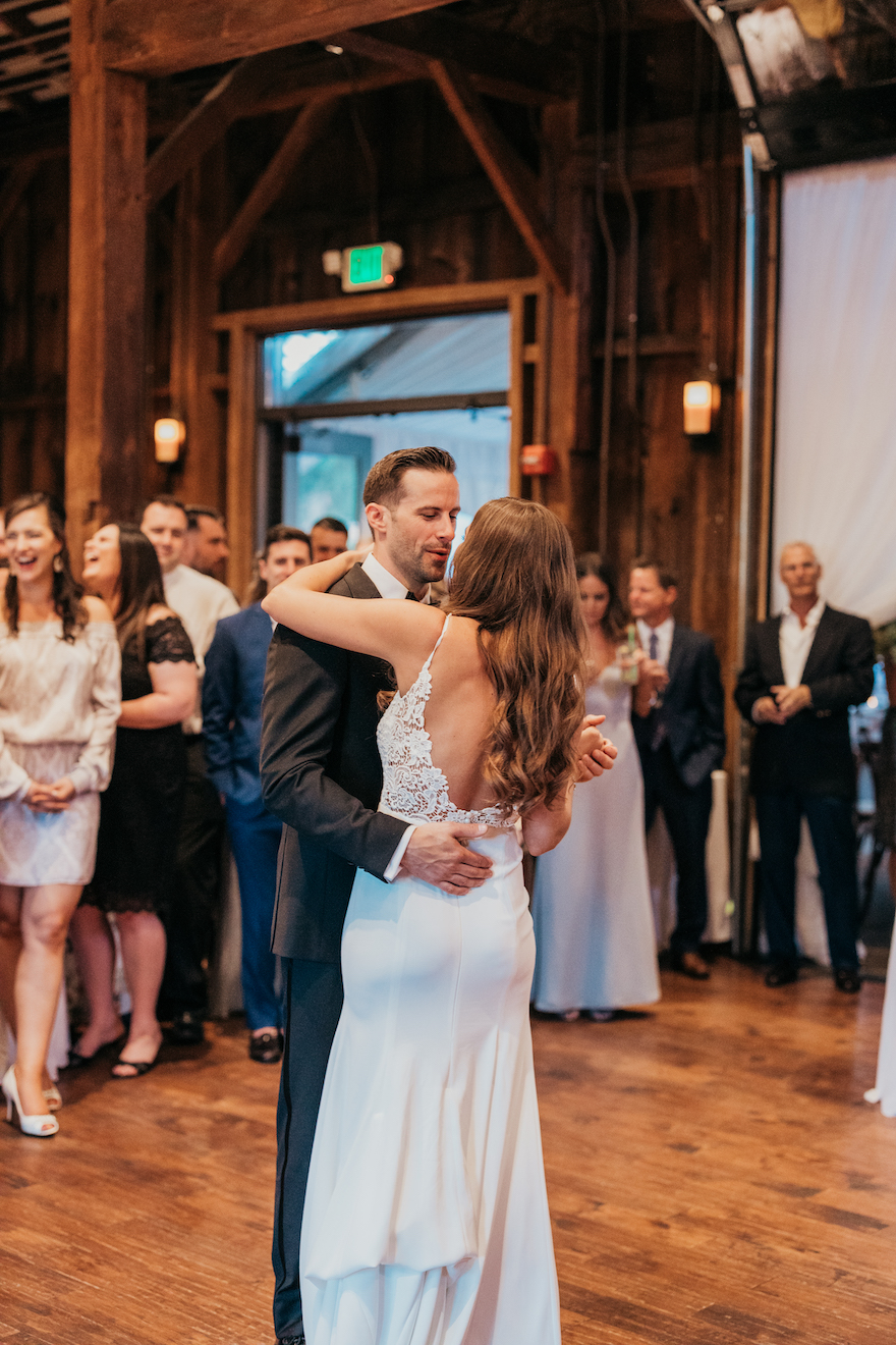 Bride and groom share their first dance: Elegant and Classic Garden Wedding planned by Exhale Events. See more at exhale-events.com!