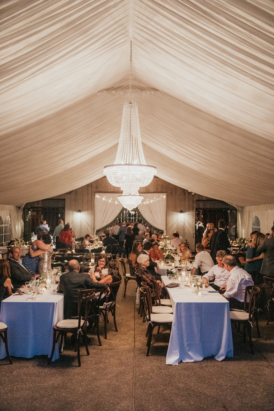 Night shot of the tent at the botanic gardens: Elegant and Classic Garden Wedding planned by Exhale Events. See more at exhale-events.com!