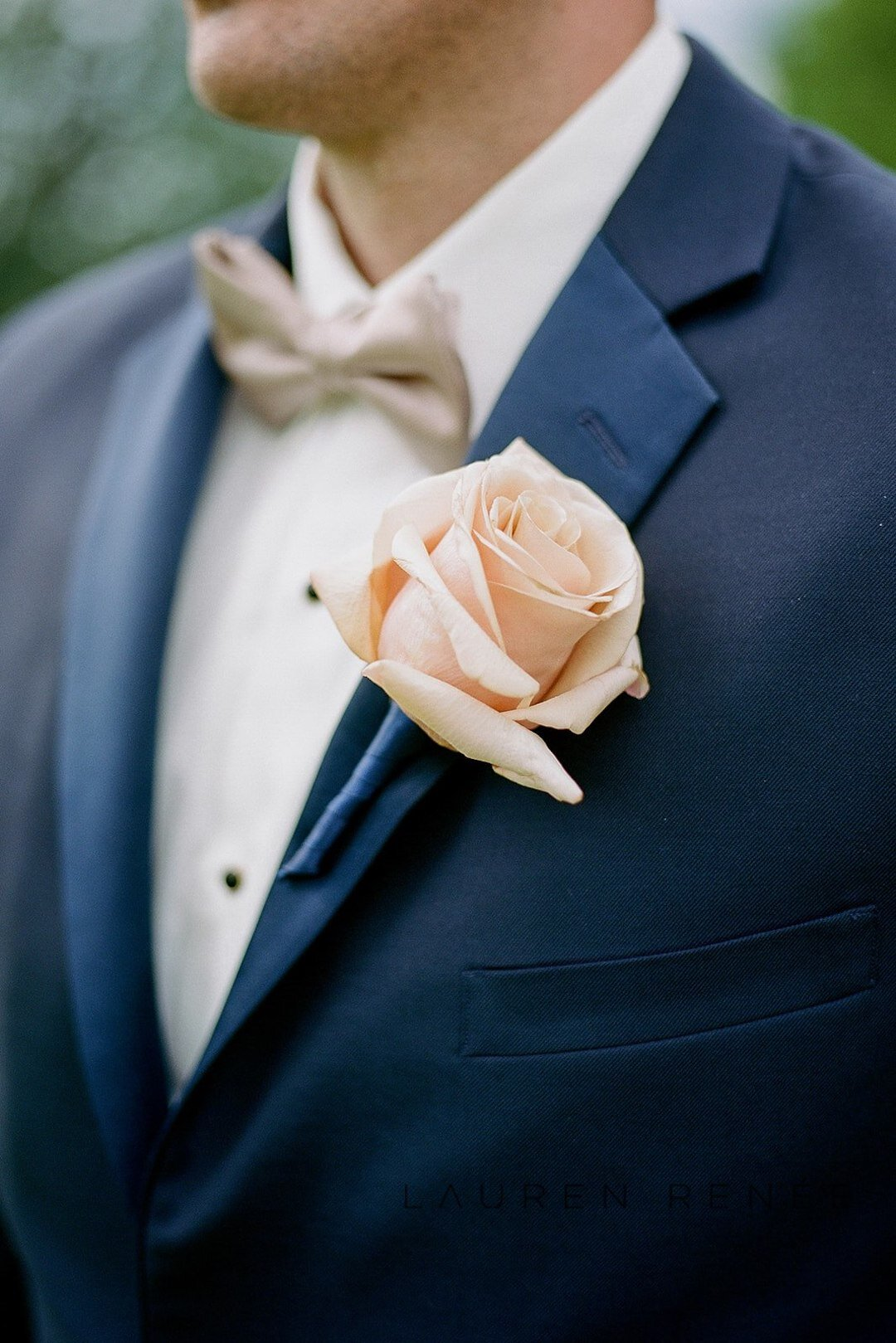 Groom in navy with pink flowers: Romantic Blush Wedding at the Pittsburgh Field Club planned by Exhale Events. See more at exhale-events.com!